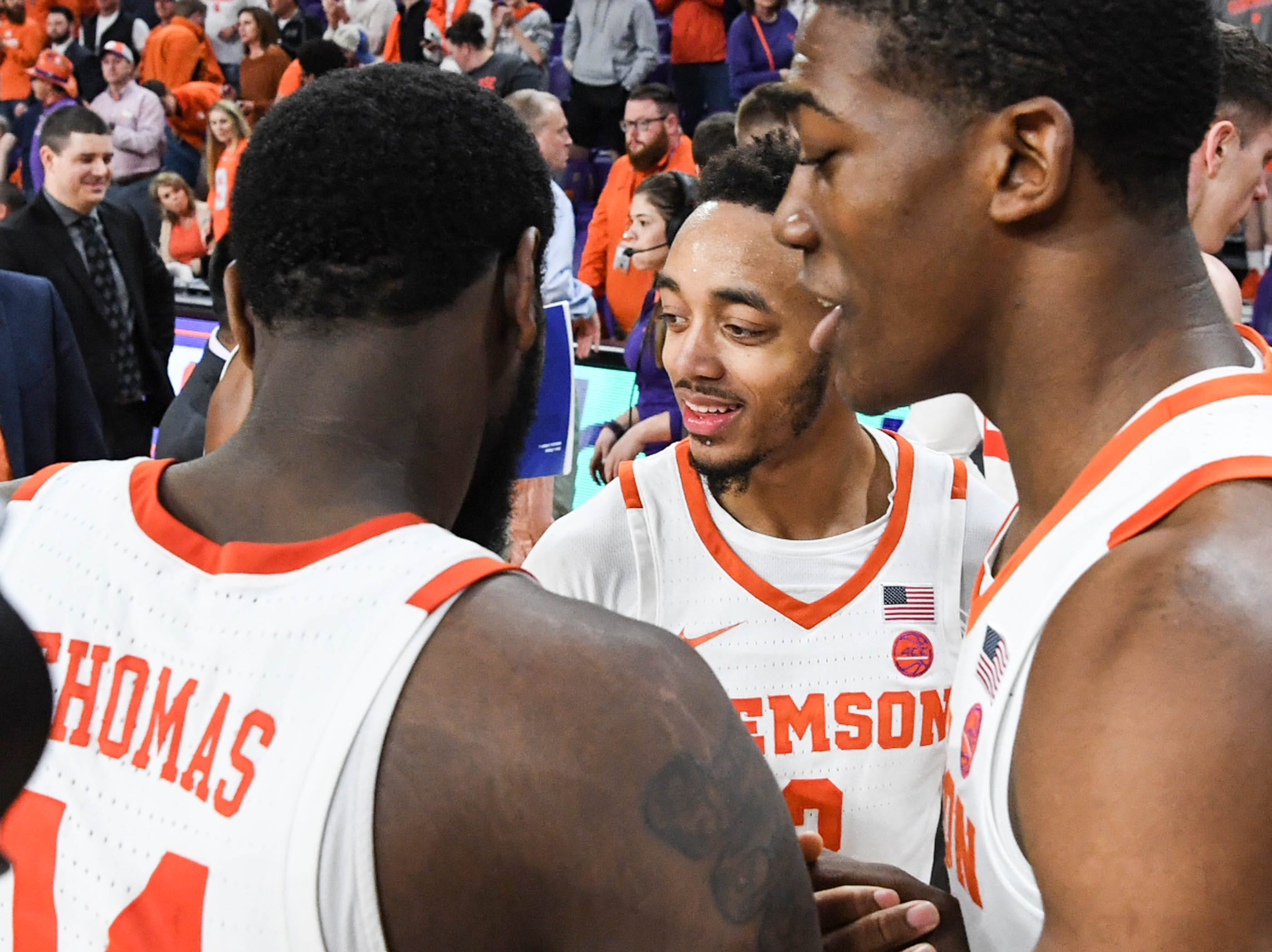 Clemson forward Elijah Thomas (14), left, guard Marcquise Reed (2), and center Trey Jemison (55) celebrates a 67-55 win over Syracuse in Littlejohn Coliseum Saturday, March 9, 2019.