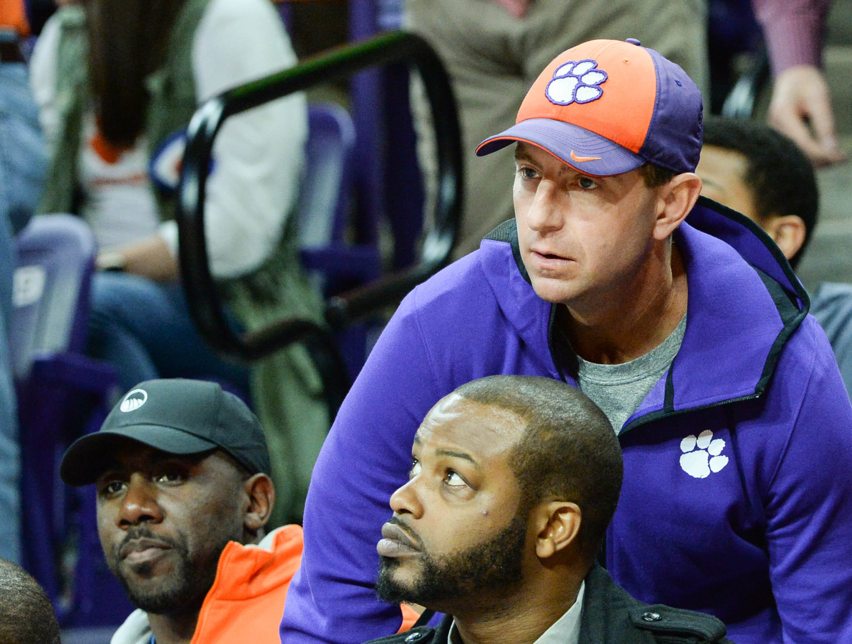 Former football star C.J. Spiller, left, and Clemson Head Football Coach Dabo Swinney attend the Syracuse game, during the second half in Littlejohn Coliseum in Clemson Saturday, March 9, 2019.