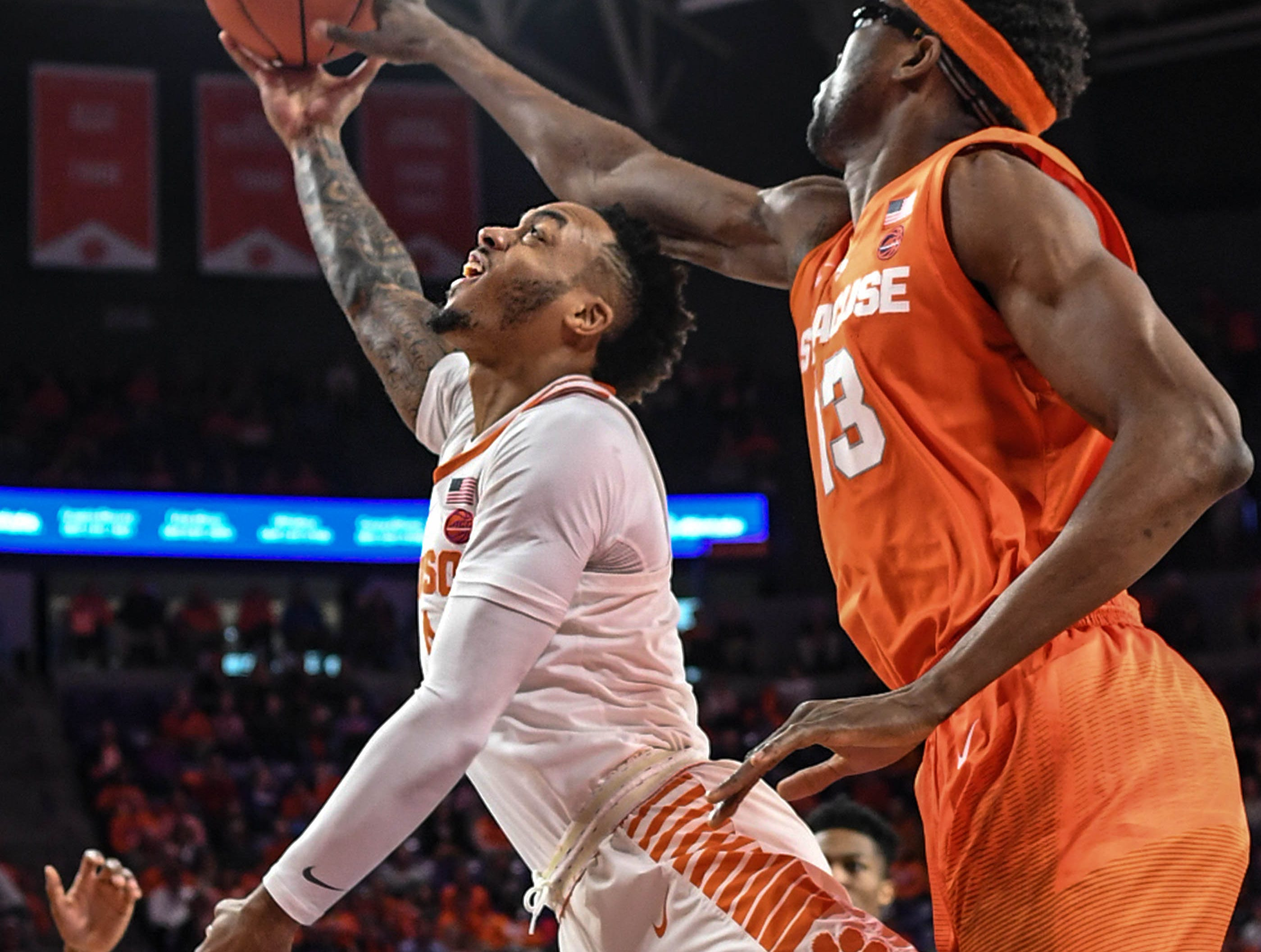 Clemson guard Marcquise Reed (2) has a shot blocked by Syracuse guard Frank Howard(23) during the first half in Littlejohn Coliseum in Clemson Saturday, March 9, 2019.
