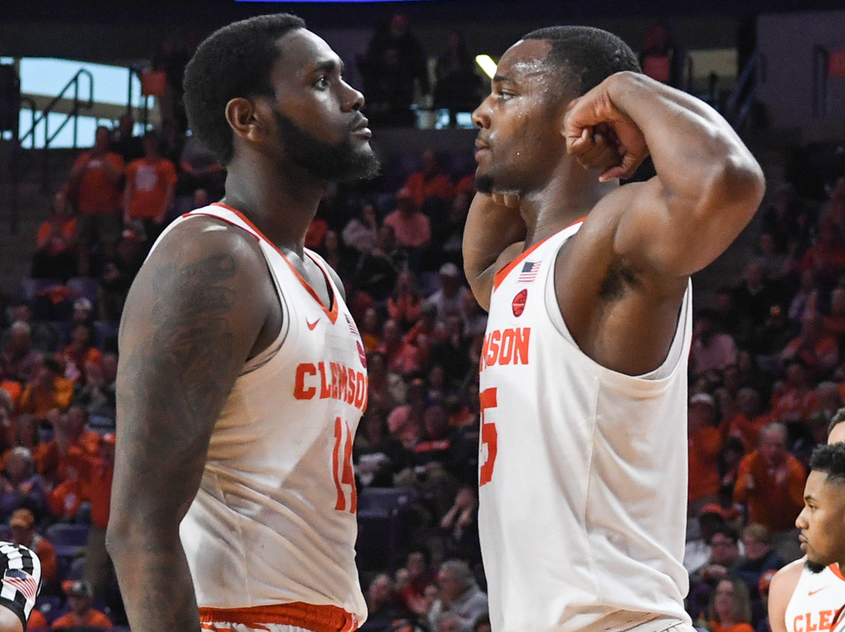 Clemson forward Elijah Thomas (14) is greeted by Clemson forward Aamir Simms (25) after making a basket against Syracuse during the second half in Littlejohn Coliseum in Clemson Saturday, March 9, 2019.