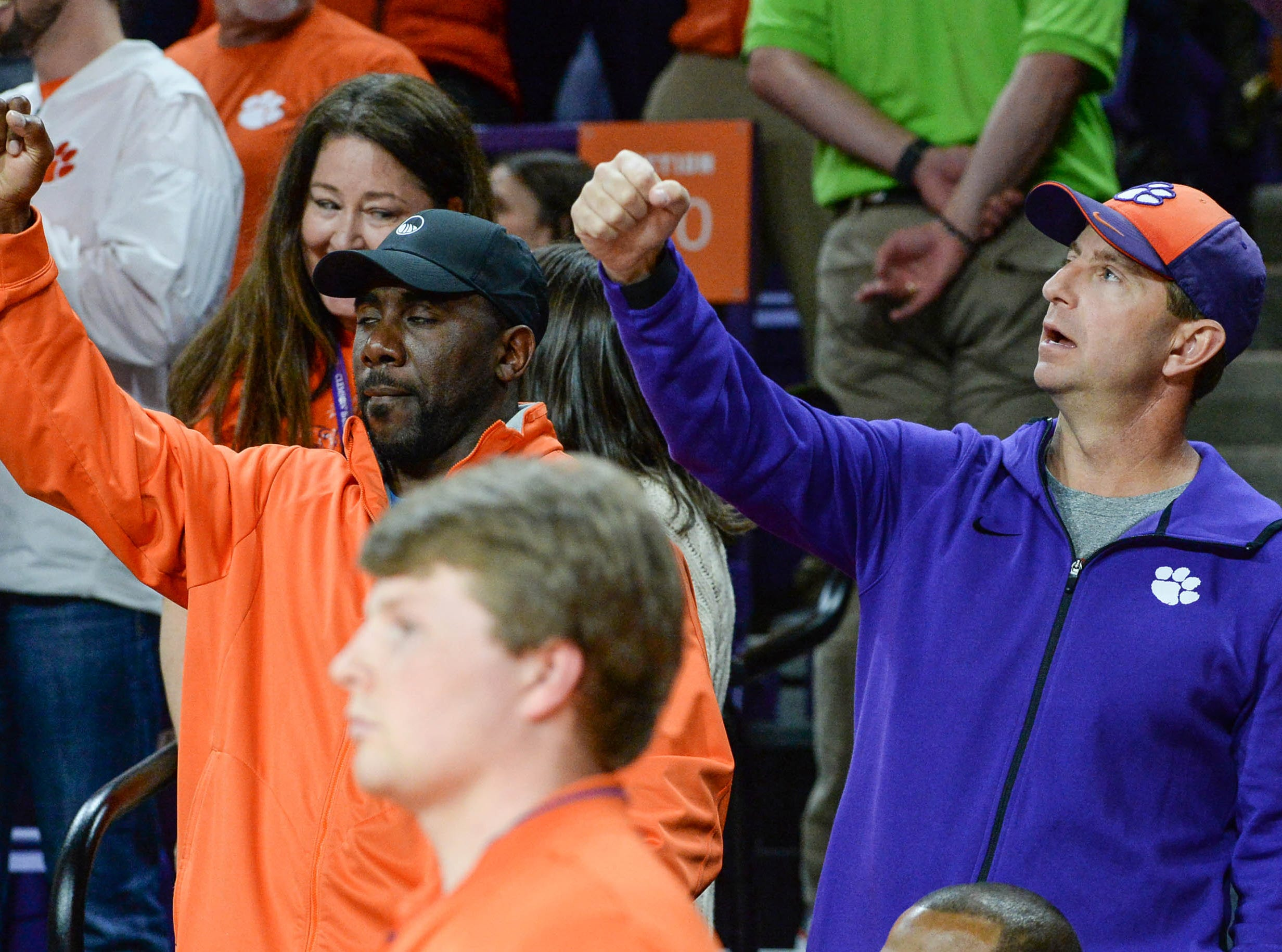 Former football star C.J. Spiller, left, and Clemson football coach Dabo Swinney cheer at the Syracuse game, during the second half in Littlejohn Coliseum in Clemson Saturday, March 9, 2019.