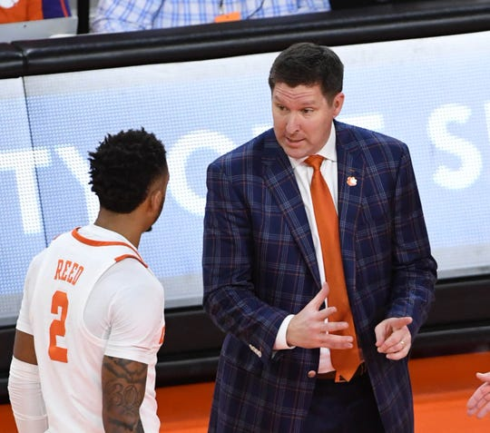 Clemson head coach Brad Brownell  talks with Clemson guard Marcquise Reed (2) during the first half in Littlejohn Coliseum in Clemson Saturday, March 9, 2019.