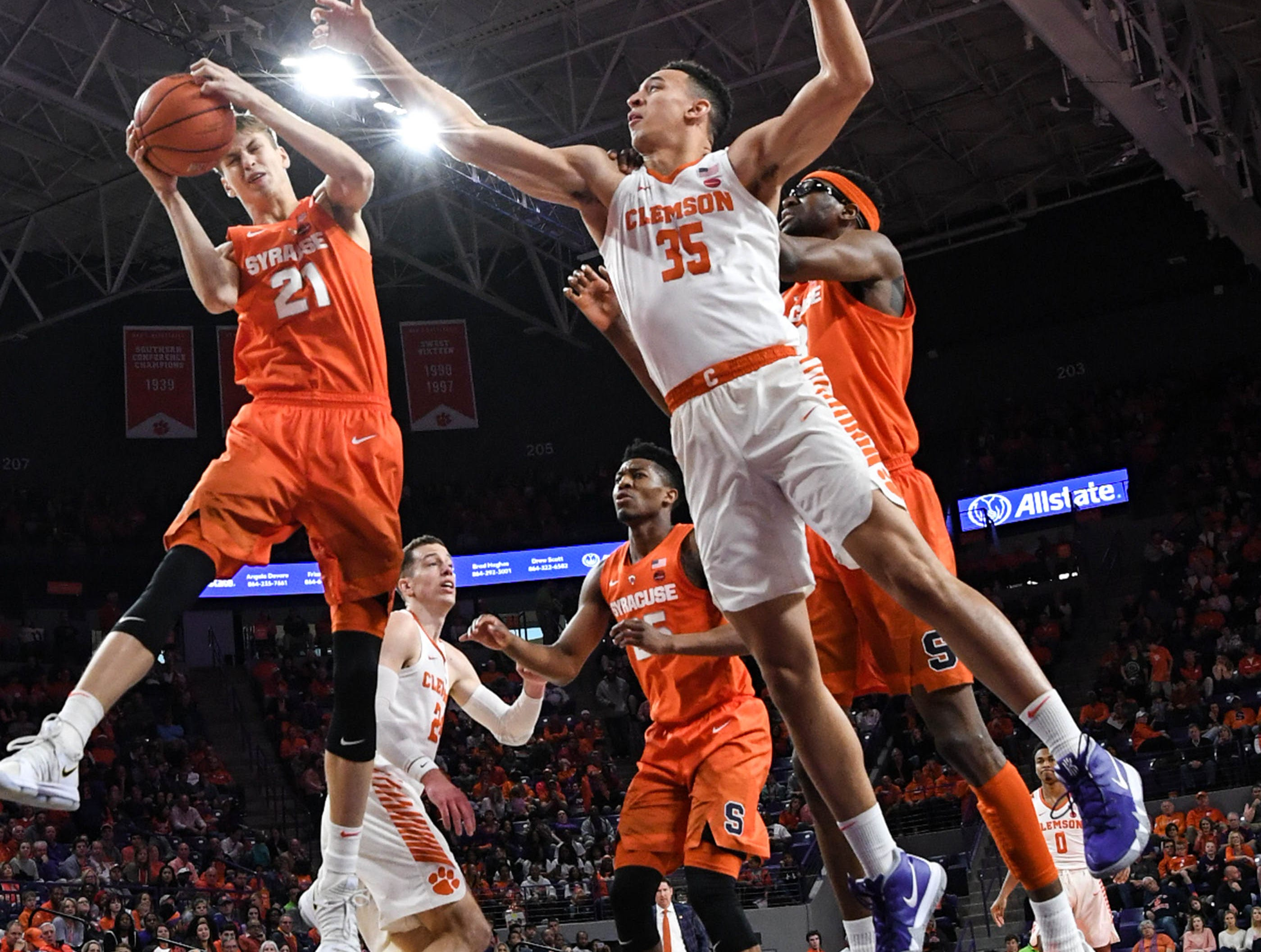 Clemson forward Aamir Simms (25) reaches as Syracuse forward Marek Dolezaj(21)rebounds during the first half in Littlejohn Coliseum in Clemson Saturday, March 9, 2019.