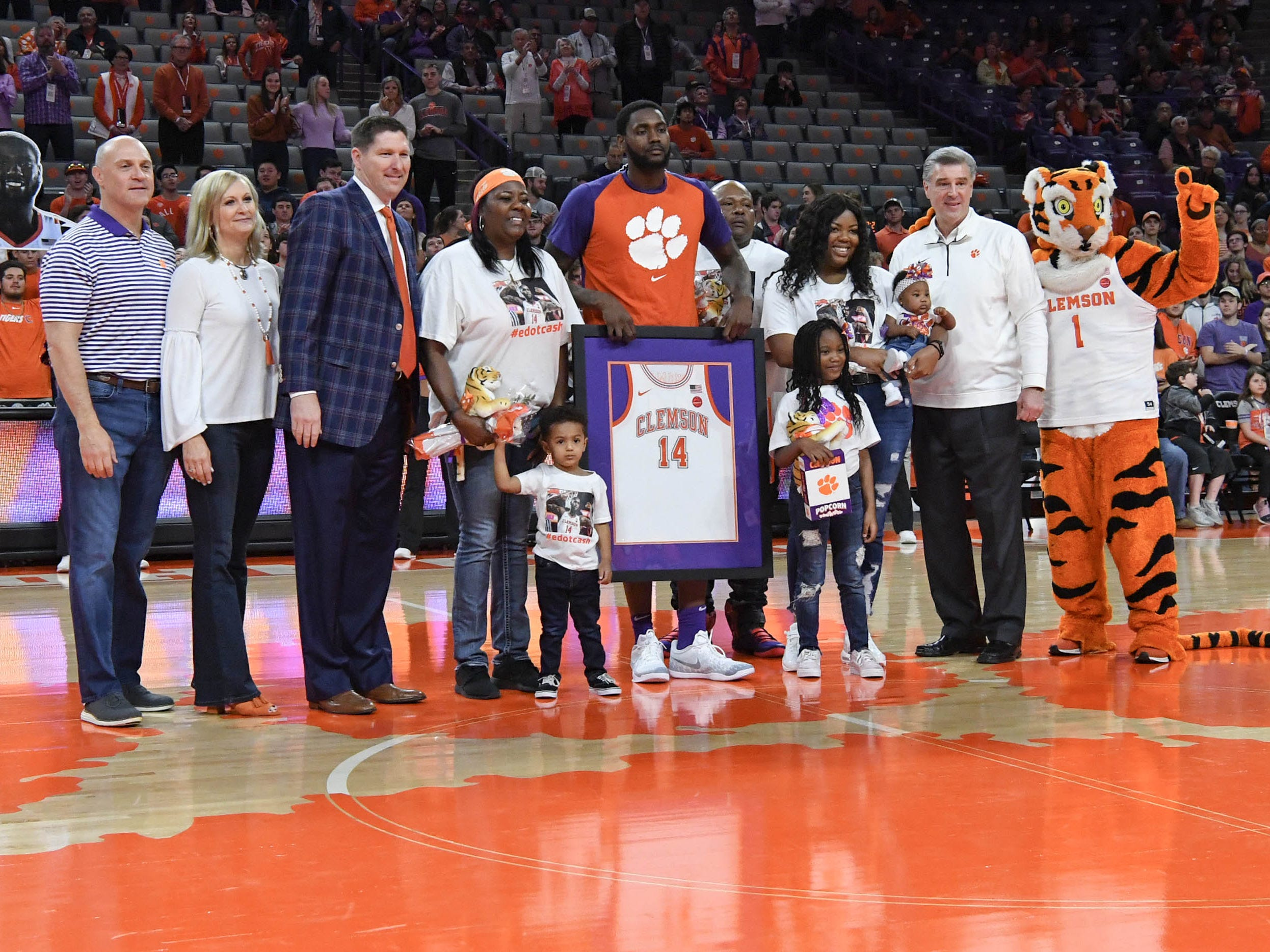 Clemson forward Elijah Thomas (14) poses with family as one of the five seniors honored before the game with Syracuse in Littlejohn Coliseum in Clemson Saturday, March 9, 2019.