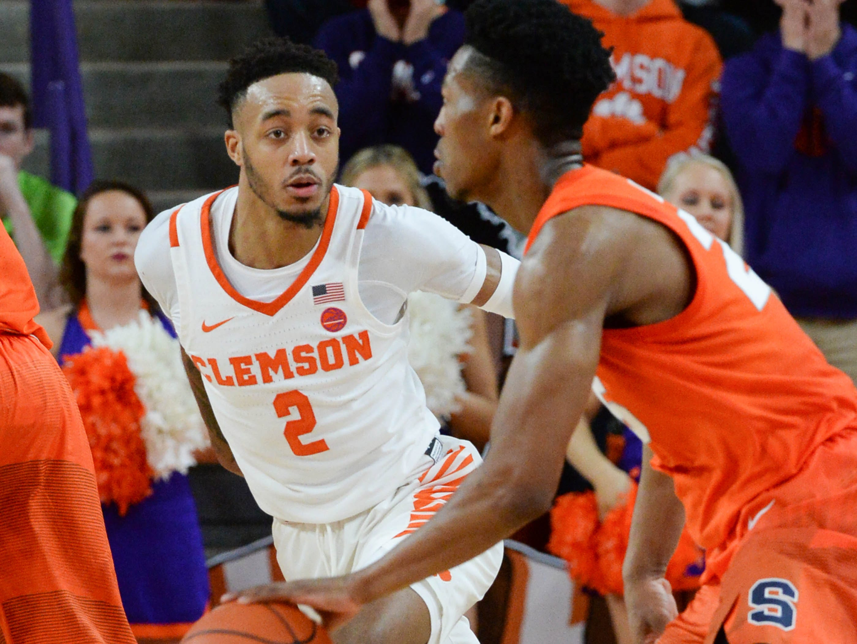 Clemson guard Marcquise Reed (2) defends Syracuse guard Frank Howard(23) during the second half in Littlejohn Coliseum in Clemson Saturday, March 9, 2019.