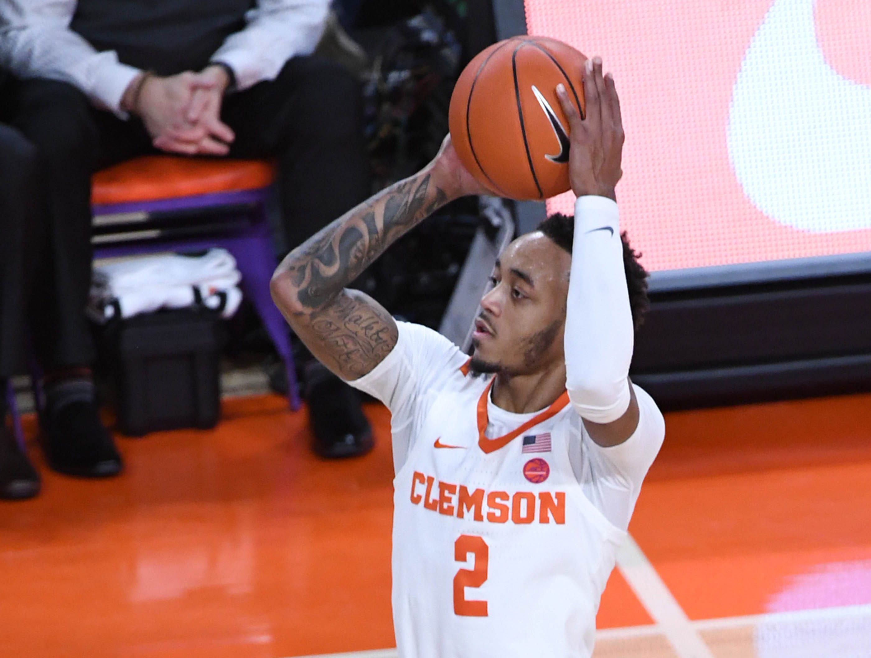 Clemson guard Marcquise Reed (2) shoots near Syracuse guard Tyus Battle(25) during the first half in Littlejohn Coliseum in Clemson Saturday, March 9, 2019.
