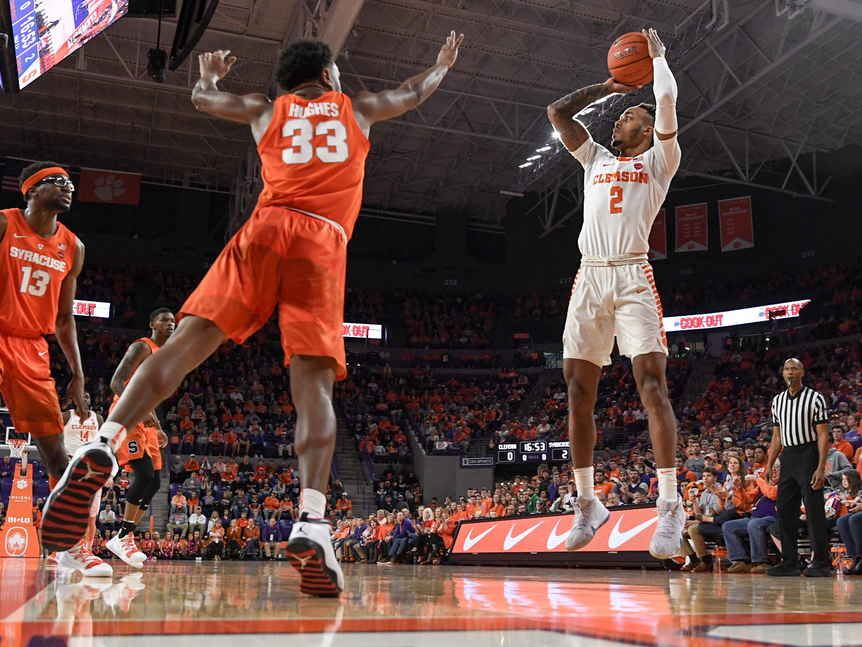 Clemson guard Marcquise Reed (2) shoots near Syracuse forward Elijah Hughes(33) during the first half in Littlejohn Coliseum in Clemson Saturday, March 9, 2019.