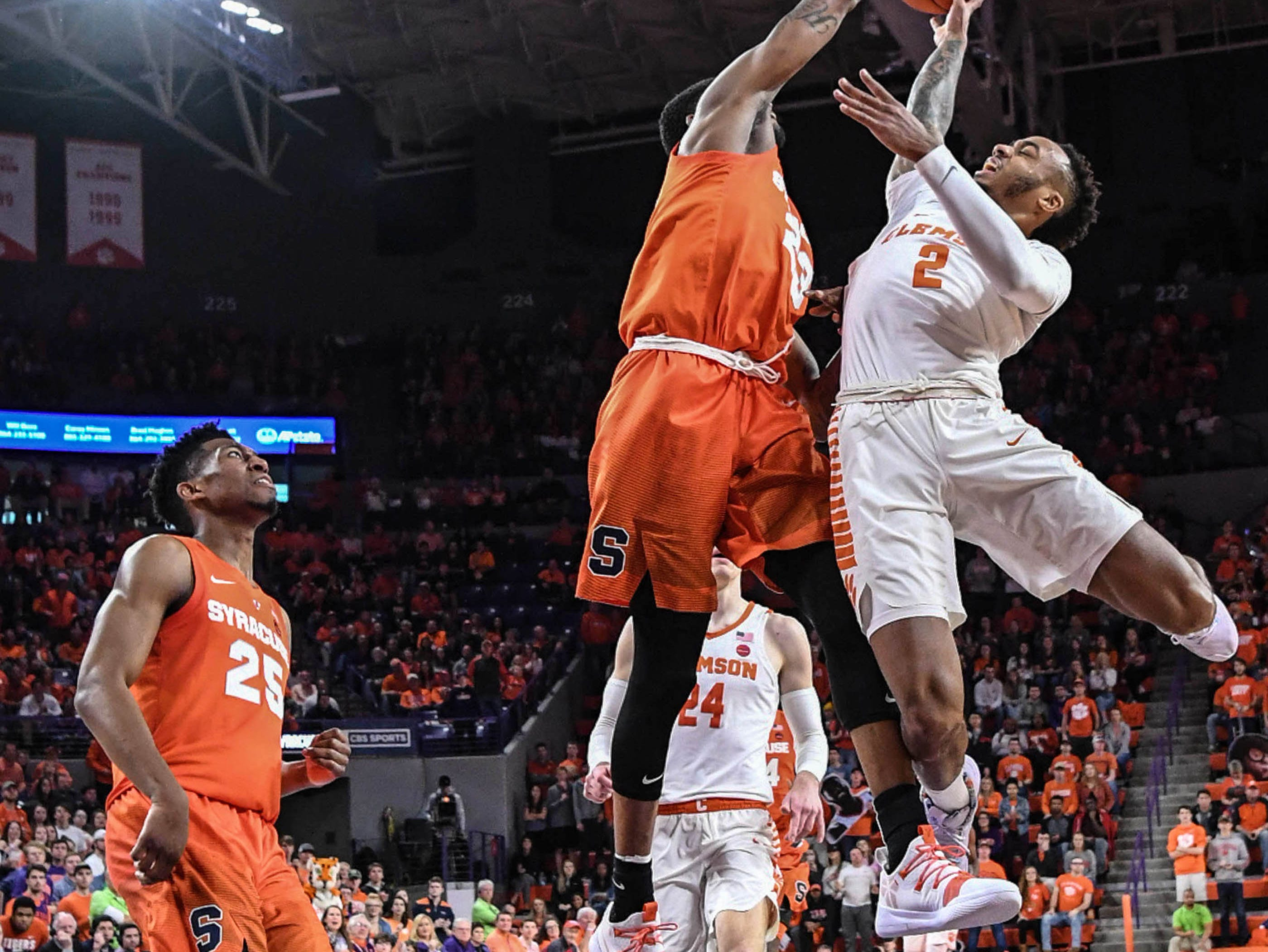 Clemson guard Marcquise Reed (2) has a shot blocked by Syracuse guard Tyus Battle(25) during the second half in Littlejohn Coliseum in Clemson Saturday, March 9, 2019.