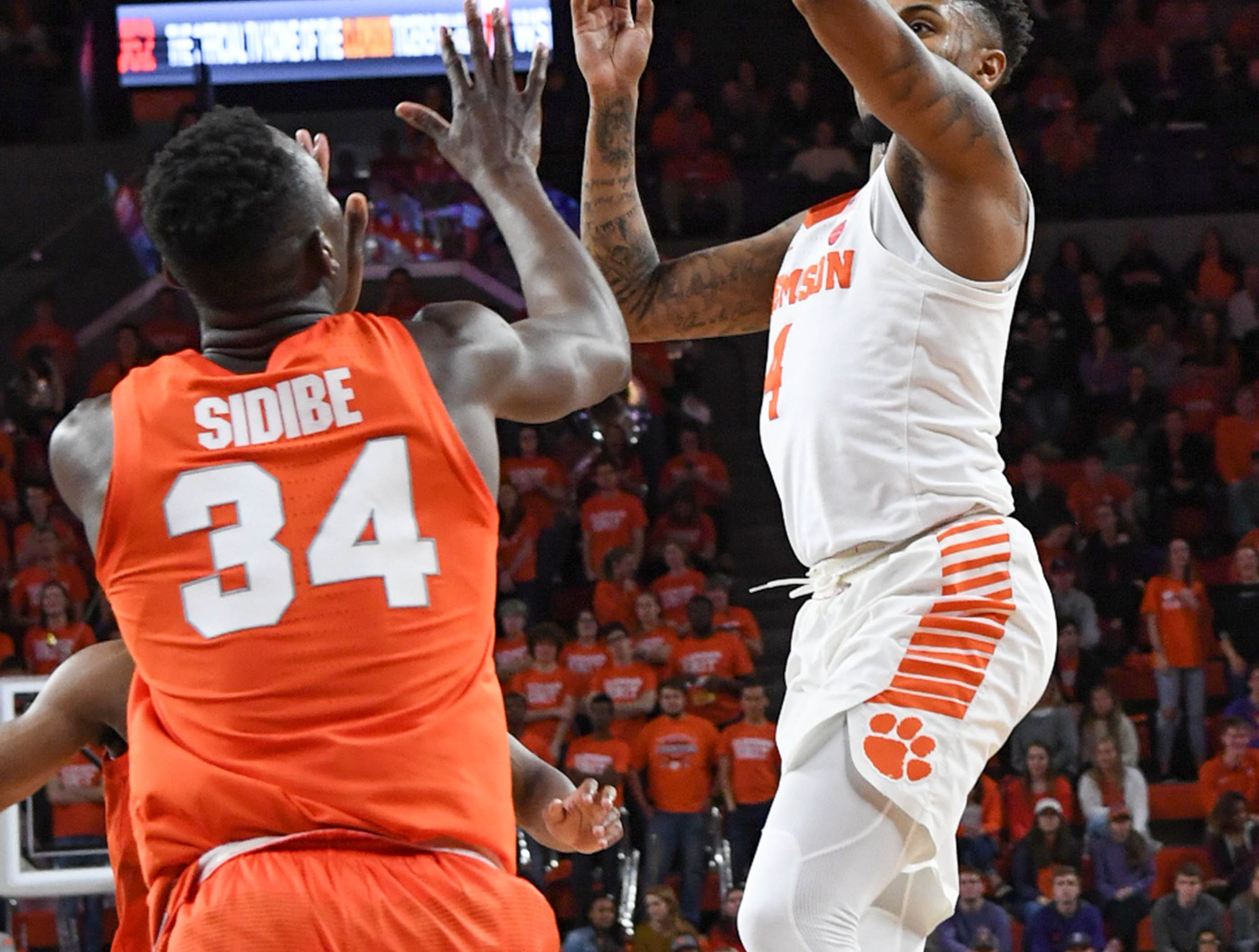 Clemson guard Shelton Mitchell (4) shoots during the second half in Littlejohn Coliseum in Clemson Saturday, March 9, 2019.