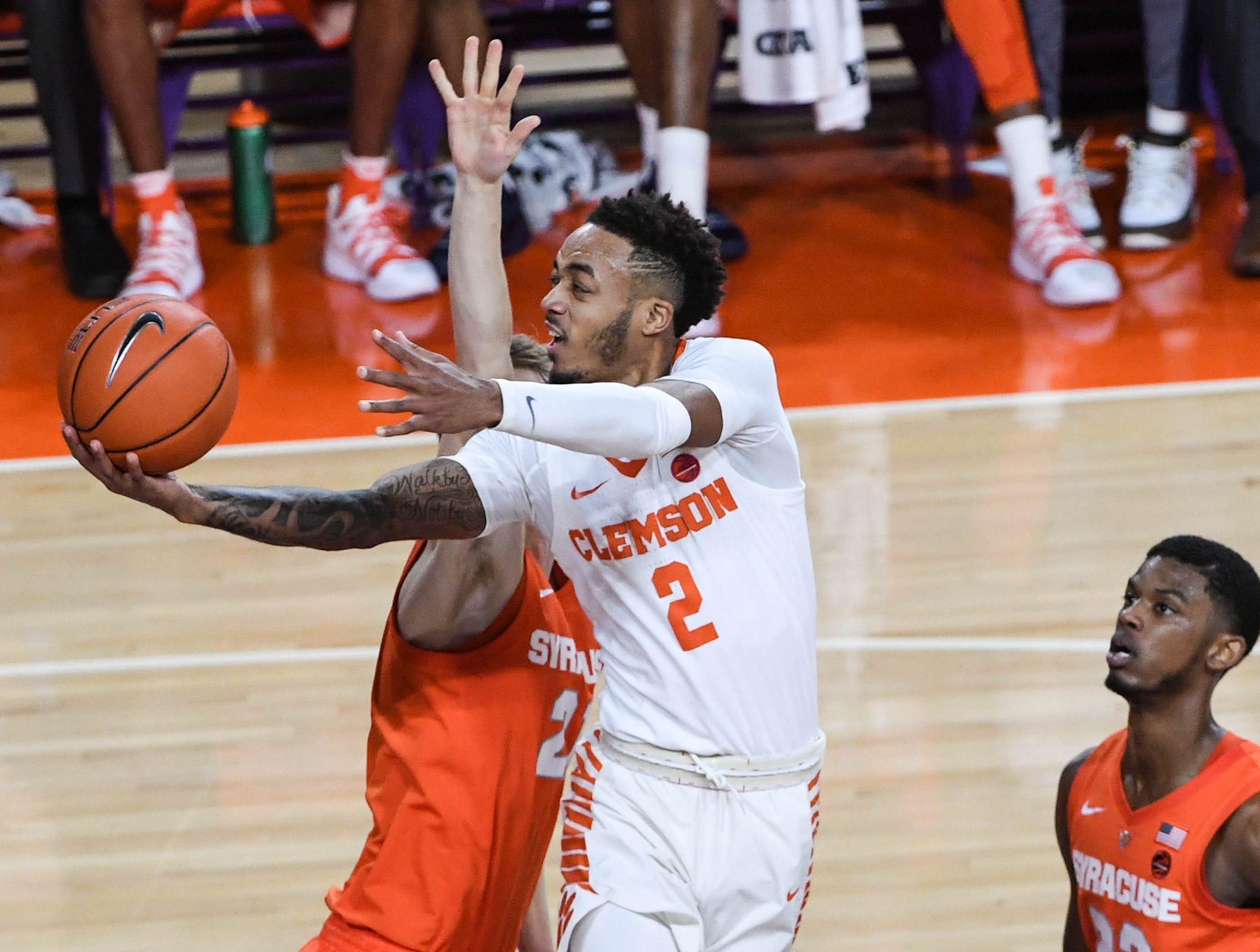 Clemson guard Marcquise Reed (2) shoots near Syracuse forward Marek Dolezaj(21) during the first half in Littlejohn Coliseum in Clemson Saturday, March 9, 2019.