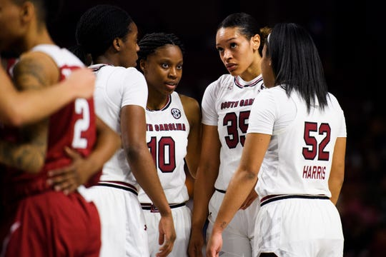 South Carolina players regroup during the SEC quarterfinals game against Arkansas at Bon Secours Wellness Arena Friday, March 8, 2019.