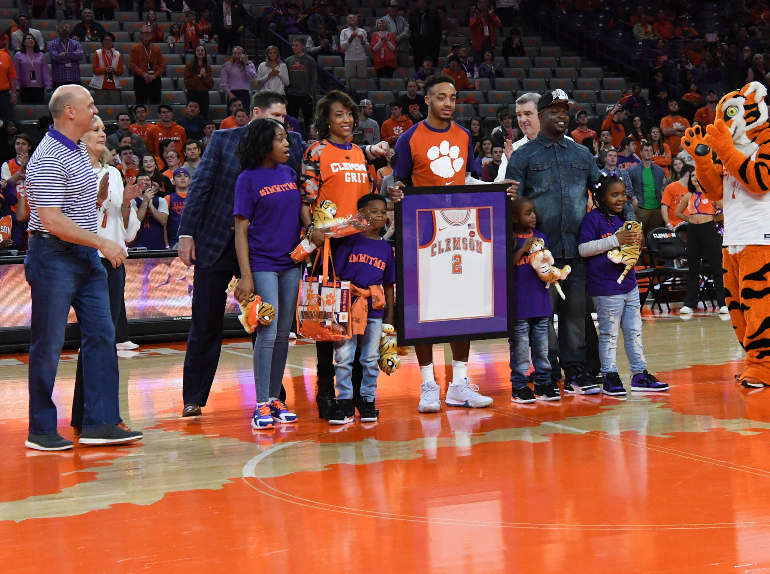 Clemson guard Marcquise Reed (2) poses with family as one of the five seniors honored before the game with Syracuse in Littlejohn Coliseum in Clemson Saturday, March 9, 2019.