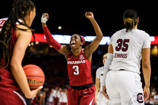 Arkansas' Malica Monk (3) celebrates as game time nears the end of the fourth quarter during the SEC quarterfinals game against South Carolina at Bon Secours Wellness Arena Friday, March 8, 2019.