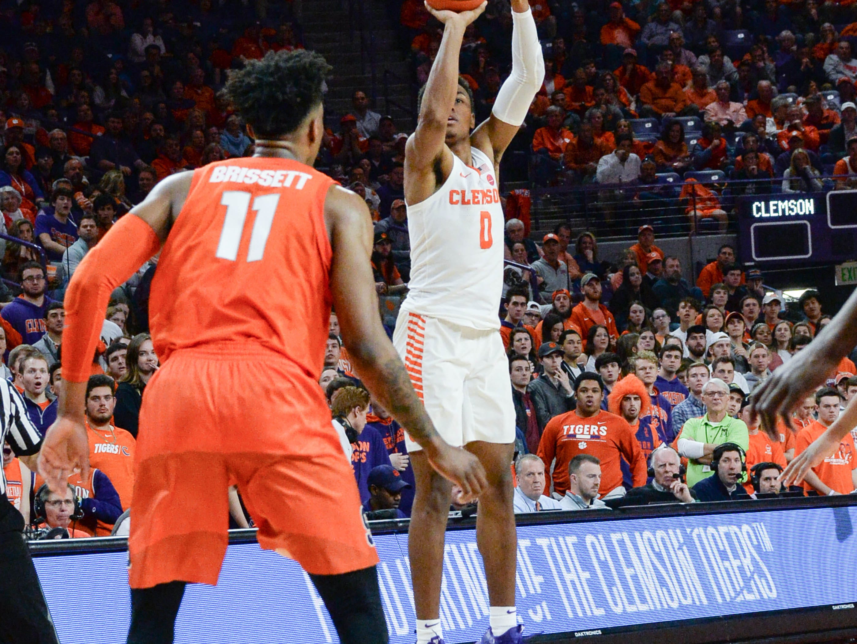 Clemson center Clyde Trapp (0) shoots near Syracuse forward Oshae Brissett(11) during the second half in Littlejohn Coliseum in Clemson Saturday, March 9, 2019.