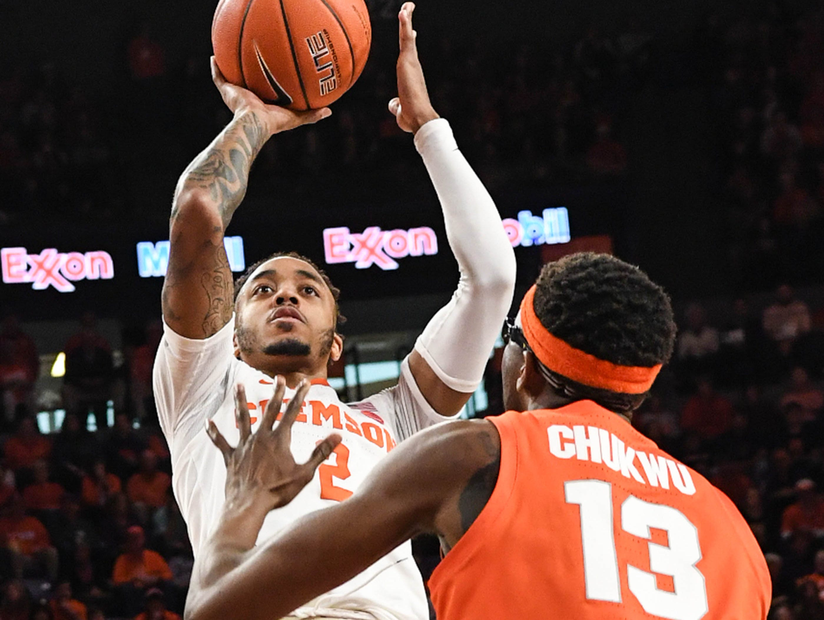 Clemson guard Marcquise Reed (2) shoots over Syracuse center Paschal Chukwu(13) during the second half in Littlejohn Coliseum in Clemson Saturday, March 9, 2019.