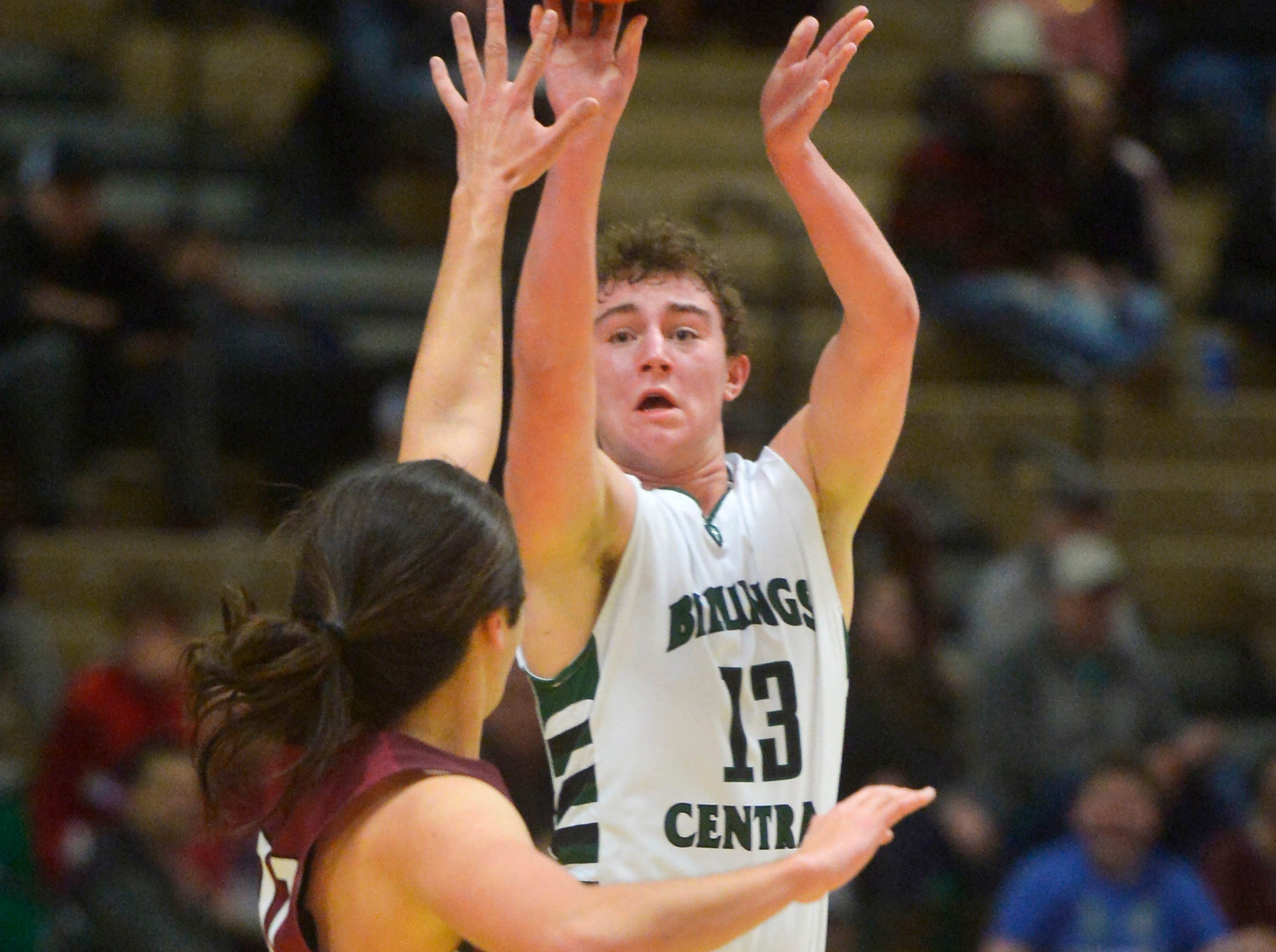 Billing's Central's Seth Sasich shoots from the outside during the semifinal game of the State Class A Basketball Tournament in the Four Seasons Arena, Friday.