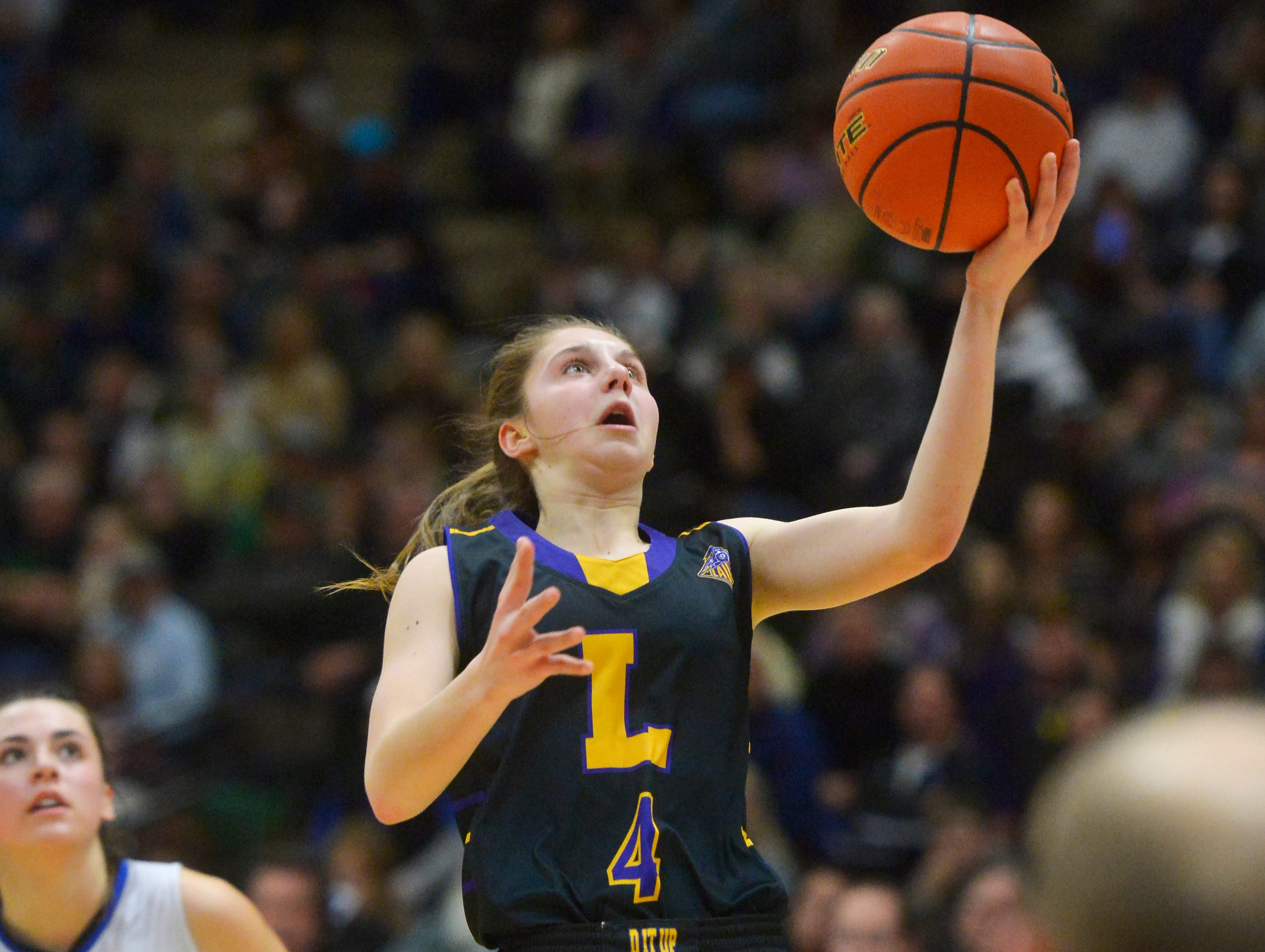 Laurel's Mya Hansen shoots a layup in the semifinal game against Havre during the State Class A Basketball Tournament in the Four Seasons Arena, Friday.