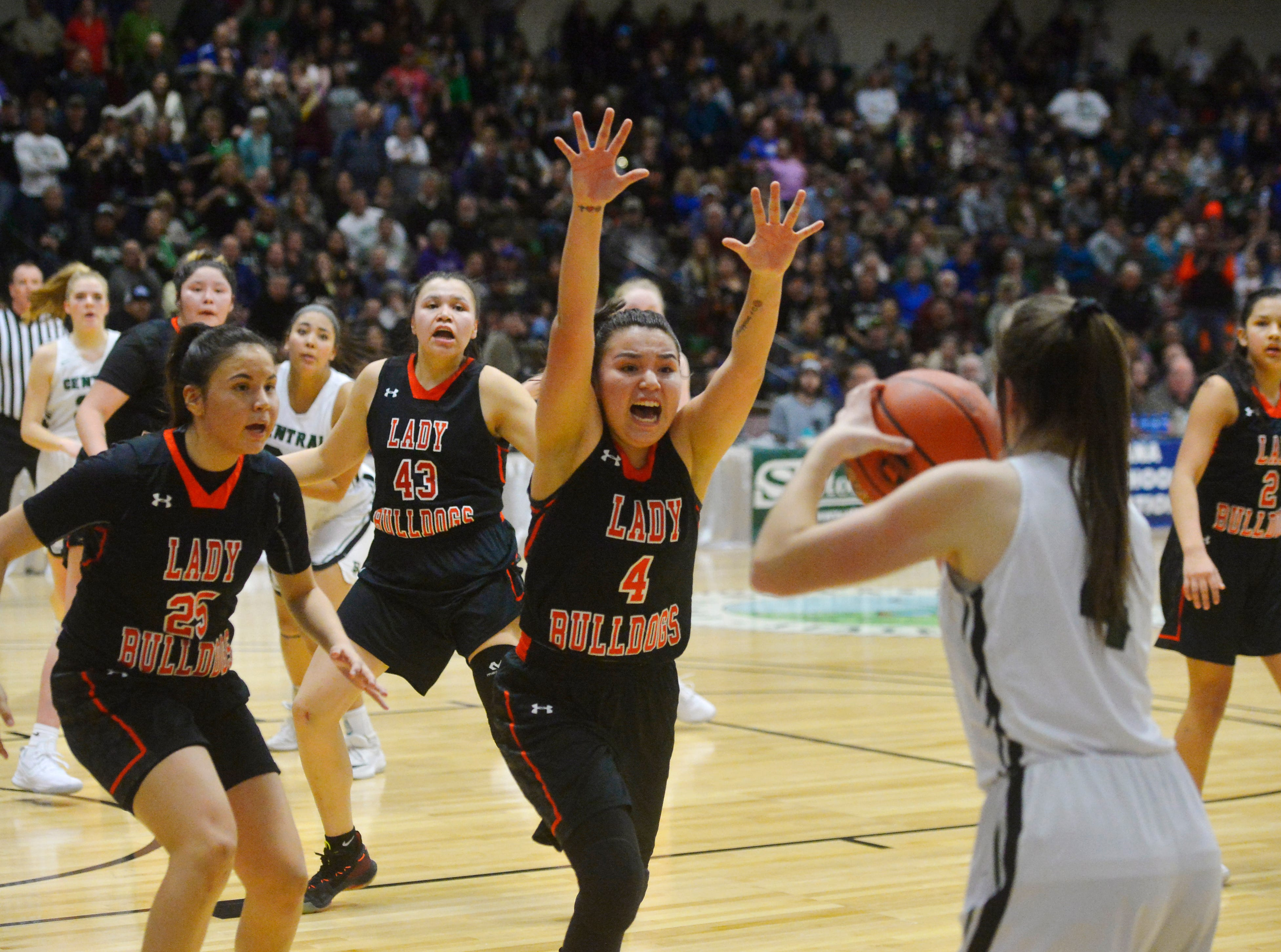Hardin's Mashaya Alden attempts to distract Billings Central's Solei Elletson's on a last second shot during the girls semifinal game of the State Class A Basketball Tournament in the Four Seasons Arena, Friday.
