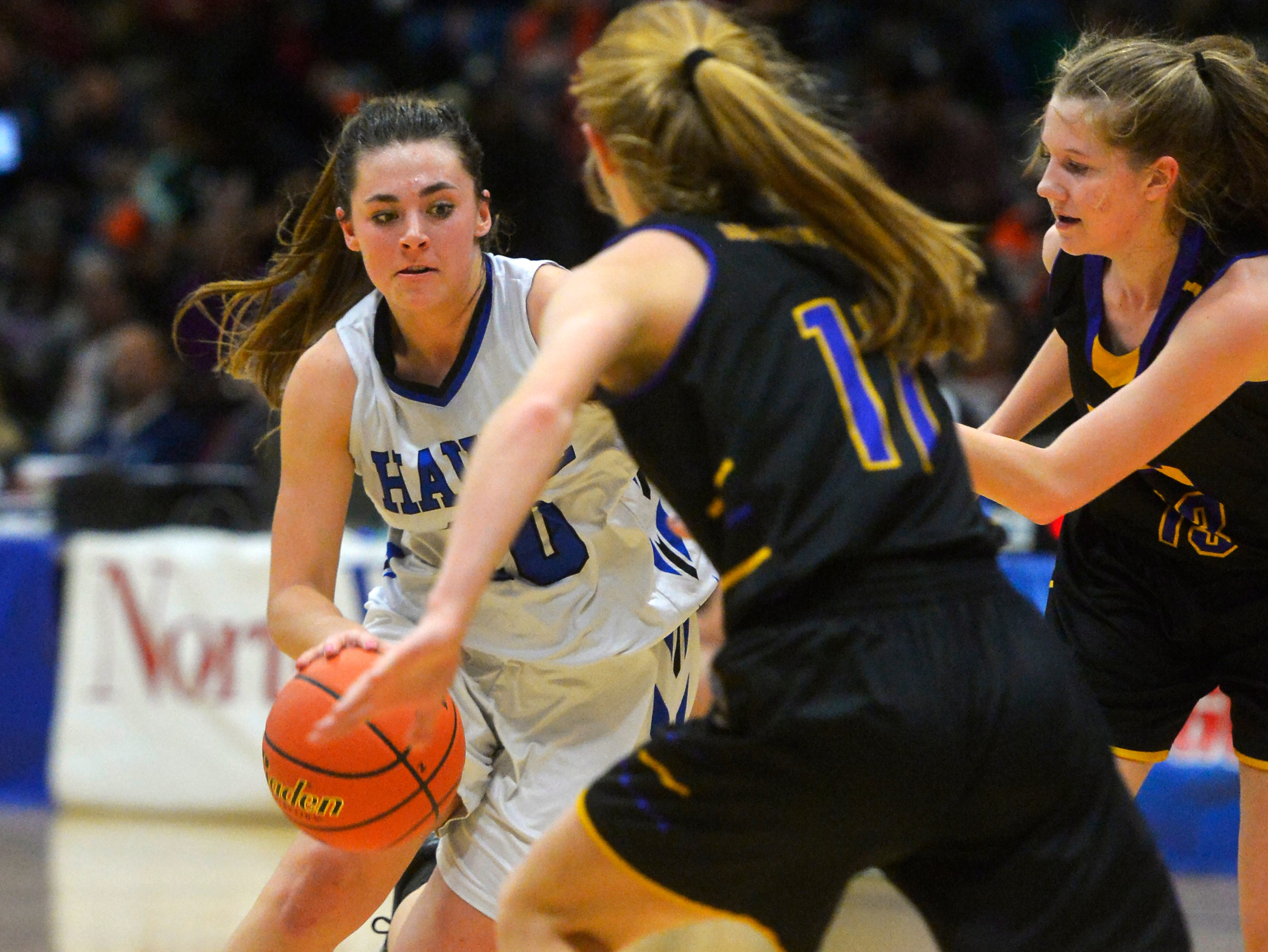 Havre's Kyndall Keller drives to the basket in the semifinal game against Laurel during the State Class A Basketball Tournament in the Four Seasons Arena, Friday.