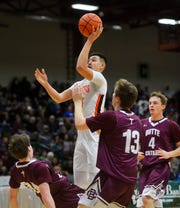 Hardin's Cayden Redfield shoots during Friday's semifinal game against Butte Central at the State Class A Basketball Tournament.