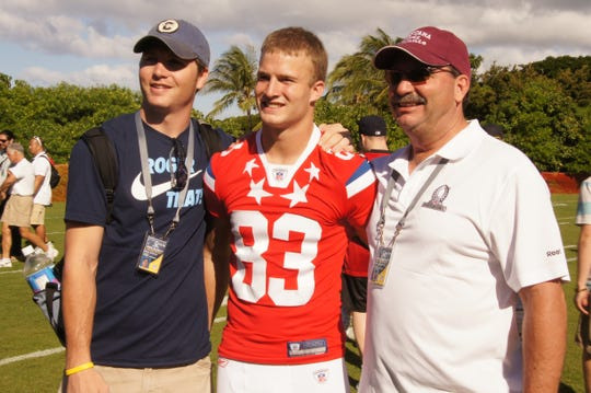 Gary Wagner, left, ex-Tennessee Titan Marc Mariani and his father Steve Mariani, at a Pro Bowl practice in Hawaii in 2011.