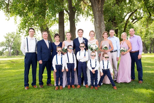 Gary Wagner and his wife, Morgan, and family members are pictured on the couple's wedding day. They are, from left, Billy, Dan, Mary, Dani, Gary, Morgan, Julie, Lance, Lisa and Andy. In front, from left, are Gary's nephews Tucker, Evan, Lane, Mack and Ace.