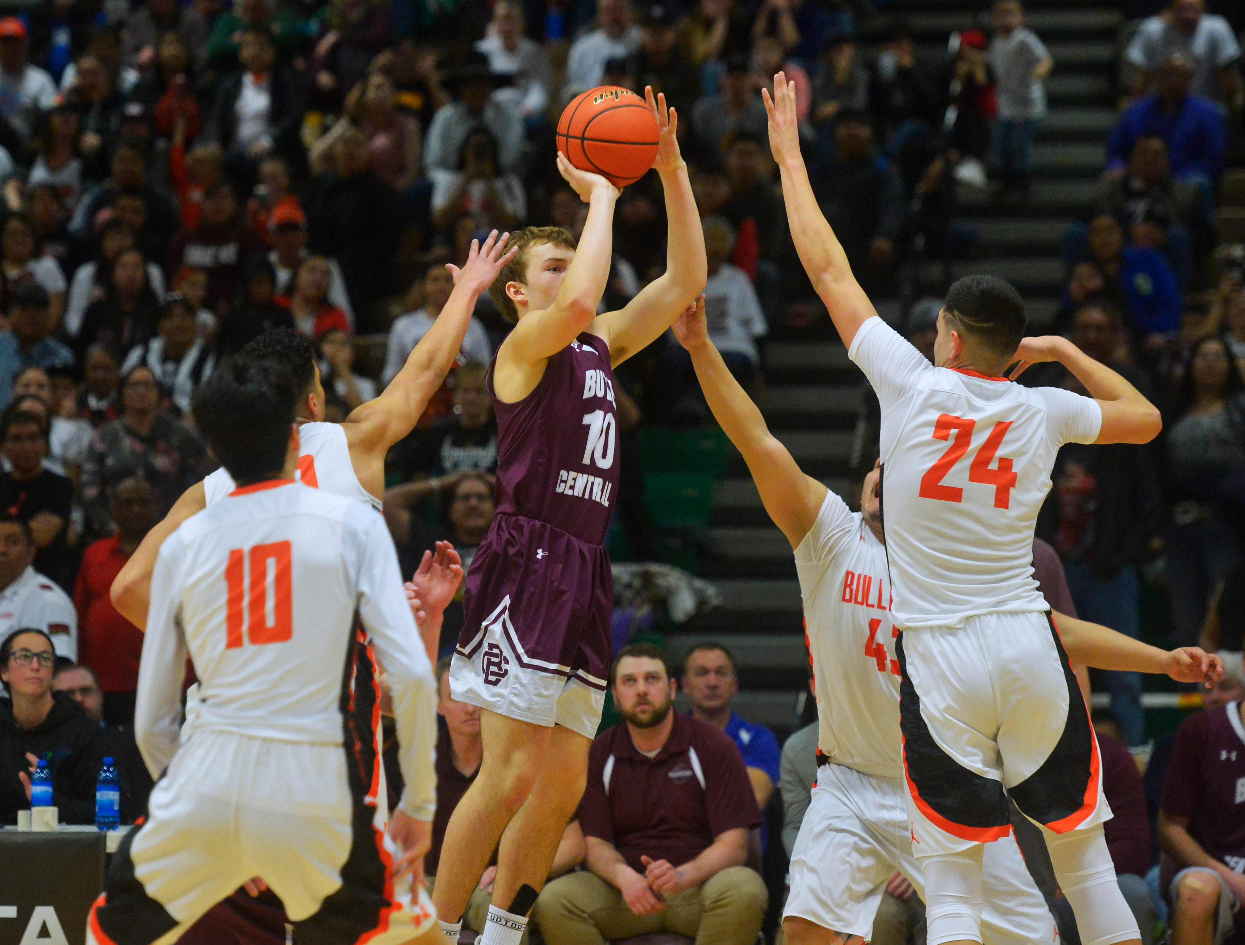 The Hardin and Butte Central boys play in the semifinal game of the State Class A Basketball Tournament in the Four Seasons Arena, Friday.