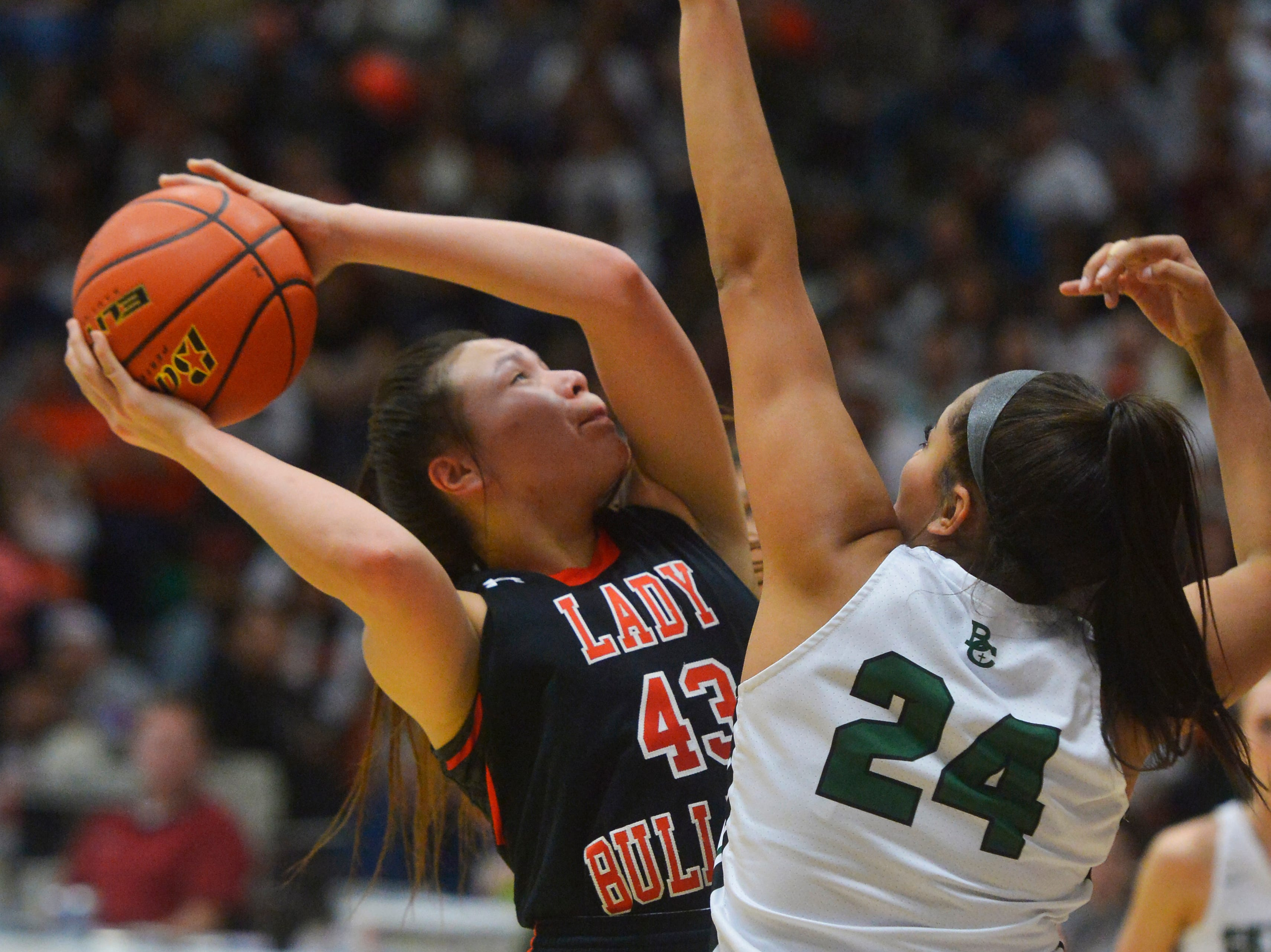 Hardin's Marie Five attempts a shot as Billings Central's Olivia Moten-Schell defends in the girls semifinal game of the State Class A Basketball Tournament in the Four Seasons Arena, Friday.