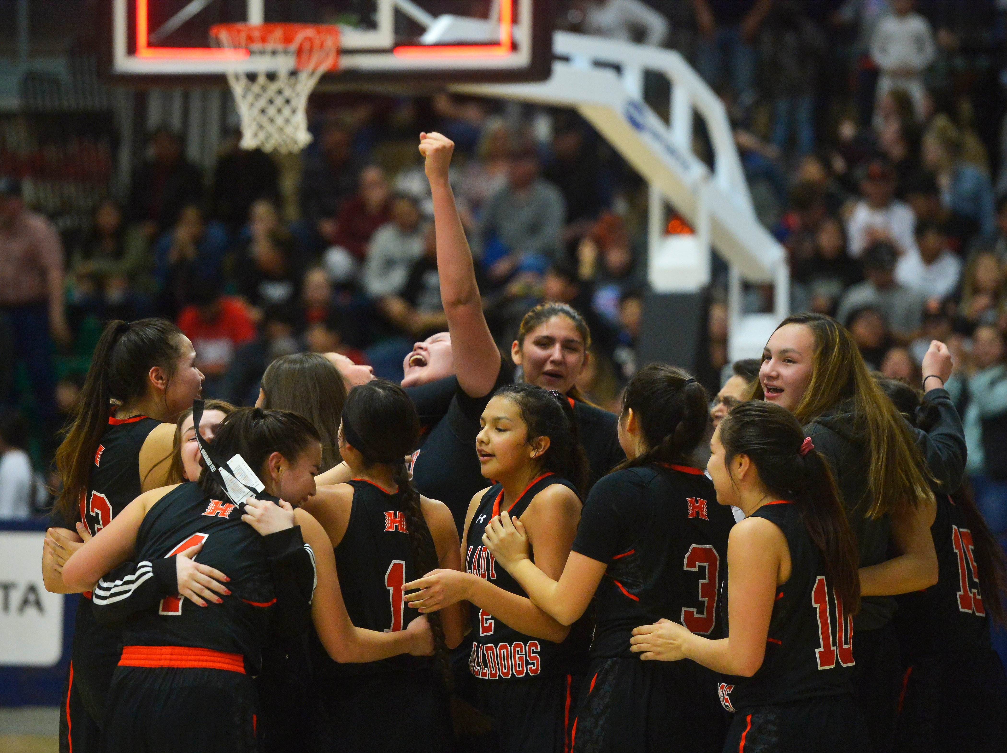 The Hardin girls celebrate their semifinal victory over Billings Central during the State Class A Basketball Tournament in the Four Seasons Arena, Friday.