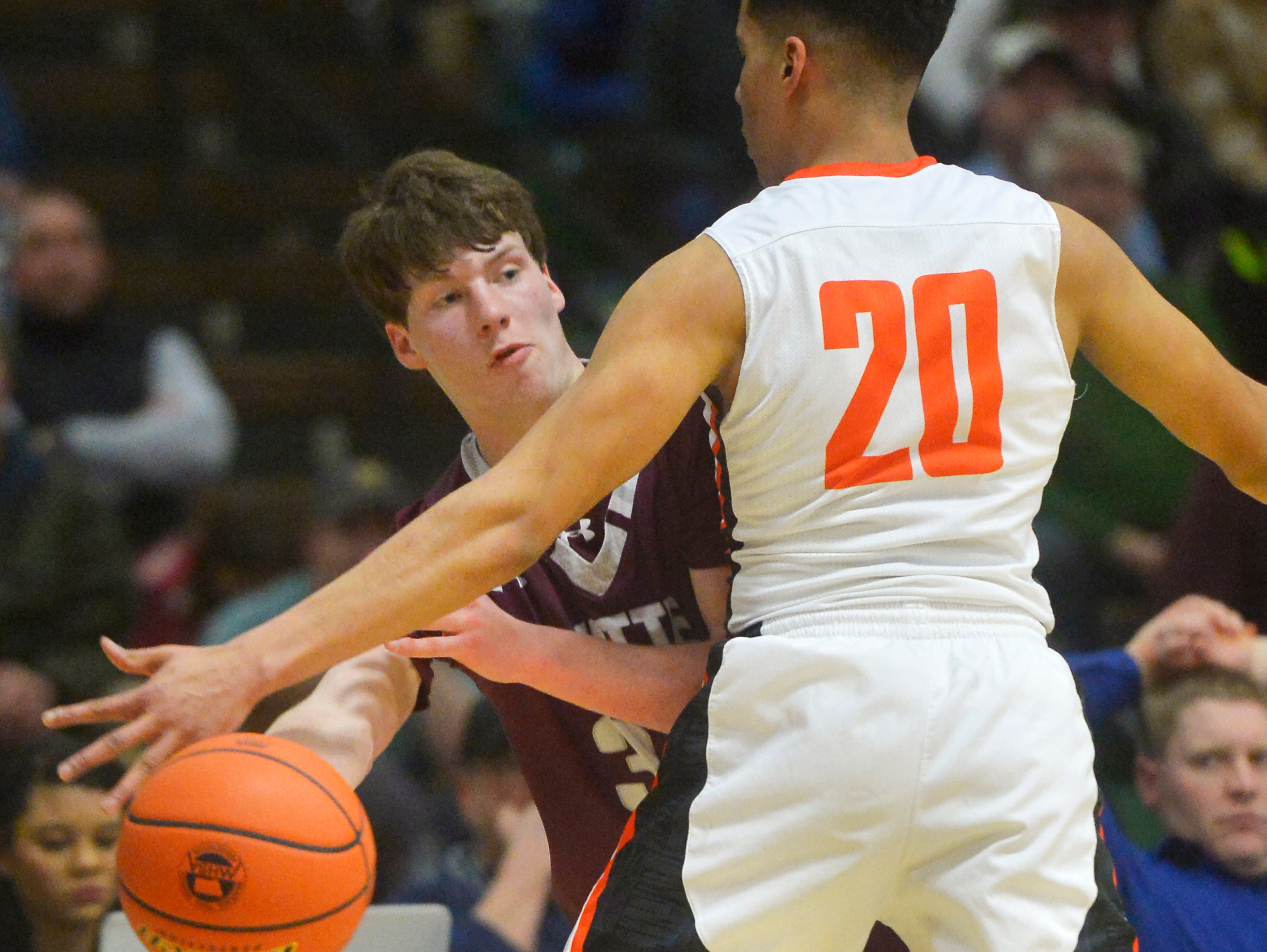 Harding and Butte Central boys play during the semifinal game of the State Class A Basketball Tournament in the Four Seasons Arena, Friday.