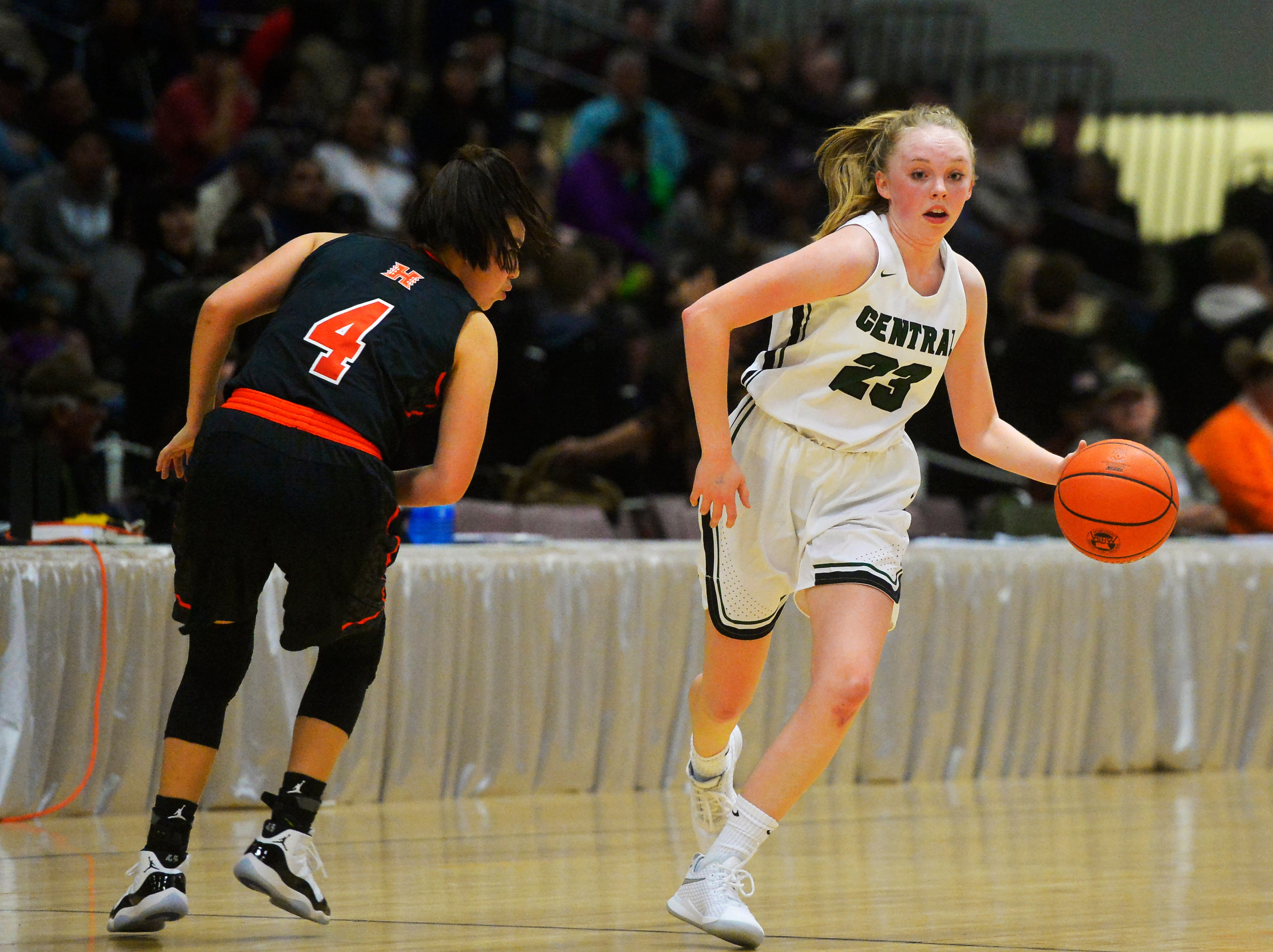 Billings Central's Isabelle Erickson pushes the ball up court in their semifinal game against Hardin during the State Class A Basketball Tournament in the Four Seasons Arena, Friday.