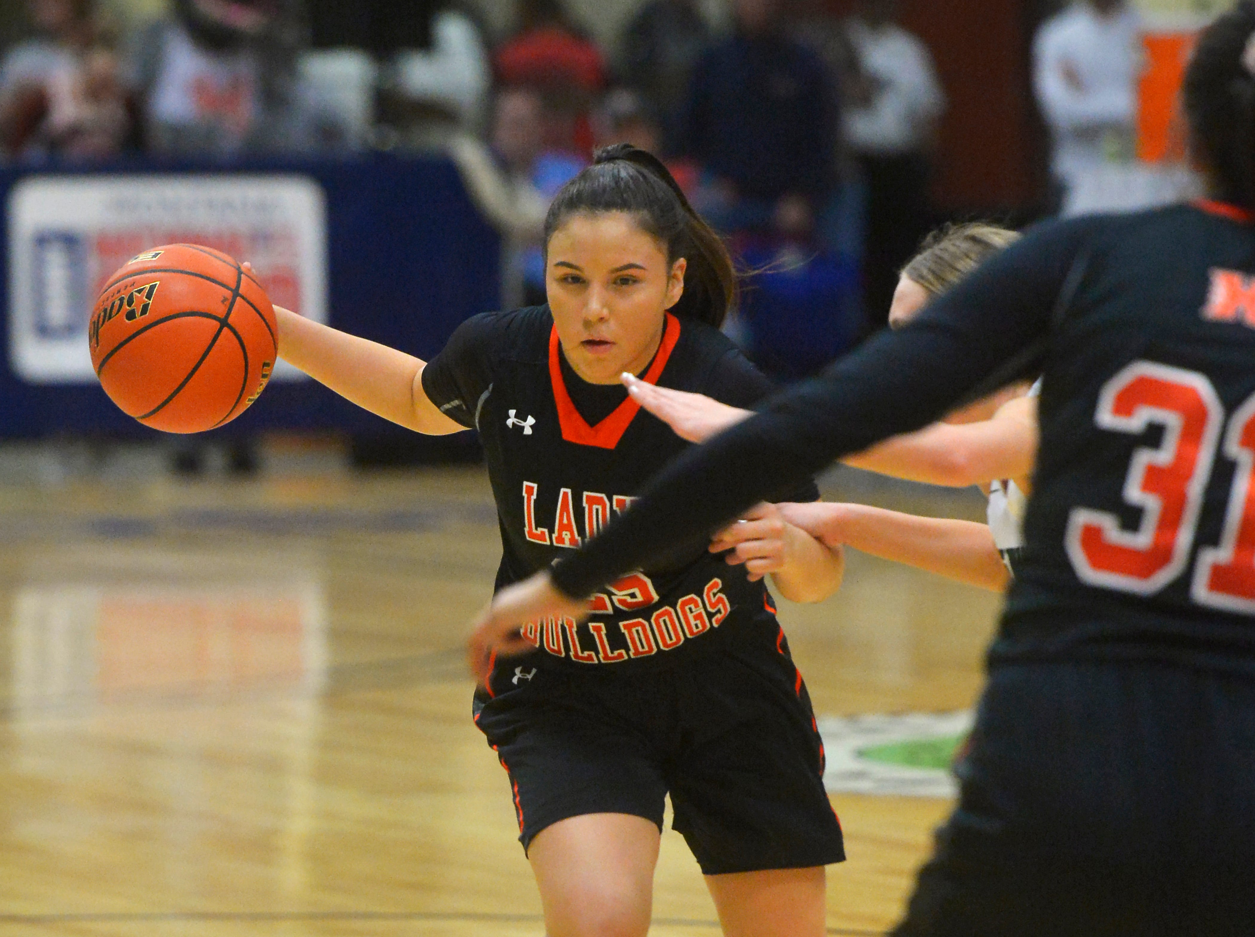 Hardin and Billings Central girls play in the semifinal game of the State Class A Basketball Tournament in the Four Seasons Arena, Friday.
