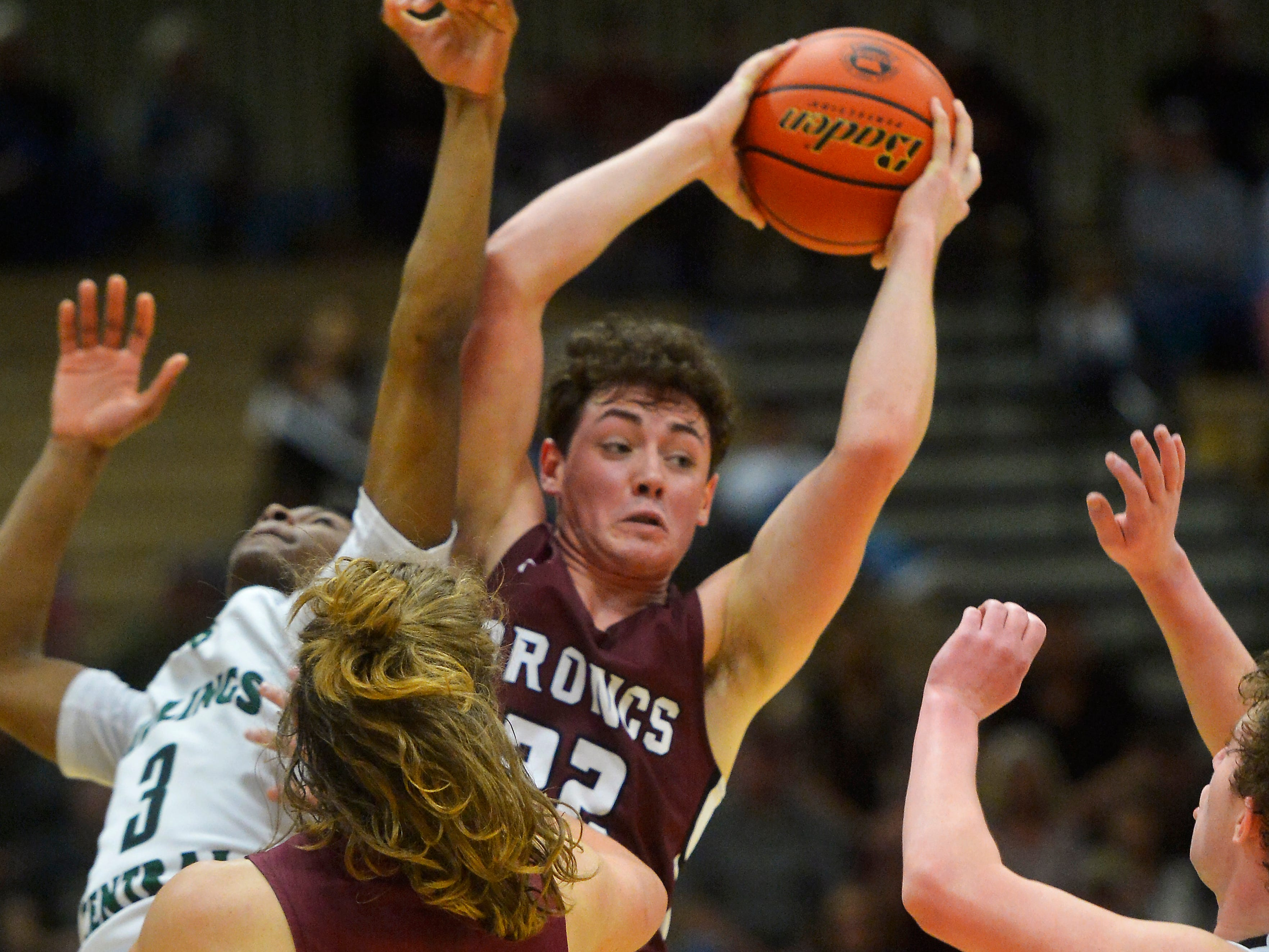 Hamilton's Hunter Omlid grabs a rebound during the semifinal game of the State Class A Basketball Tournament in the Four Seasons Arena, Friday.