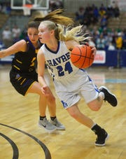 Havre's Sadie Filius heads for the basket in Friday's semifinal game against Laurel at the State Class A Basketball Tournament in the Four Seasons Arena.