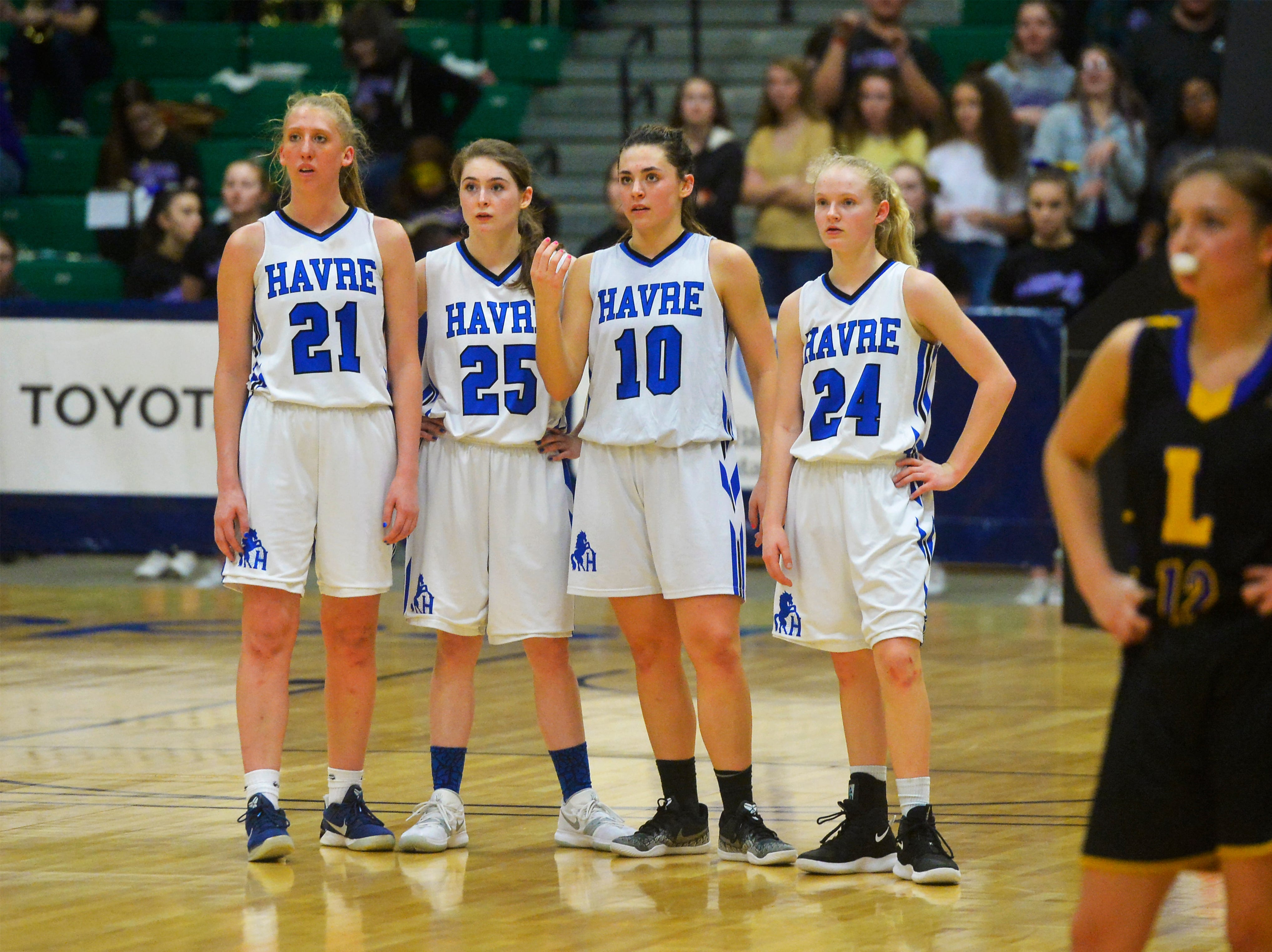 Havre players from left, Kadia Miller, Katie Wirtzberger, Kyndell Keller, and Sadie Filius look on during free throw attempts late in their semifinal game against Laurel at the State Class A Basketball Tournament in the Four Seasons Arena, Friday.