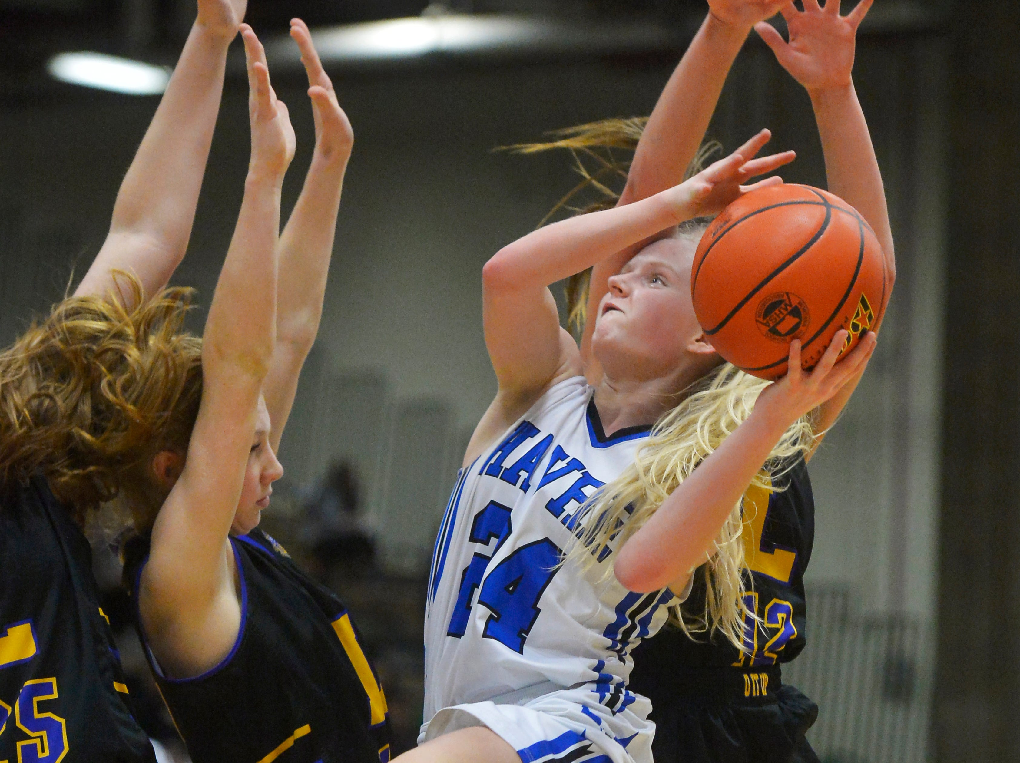 Havre's Sadie Filius attempts a shot while surrounded by Laurel defenders in the semifinal round of the State Class A Basketball Tournament in the Four Seasons Arena, Friday.