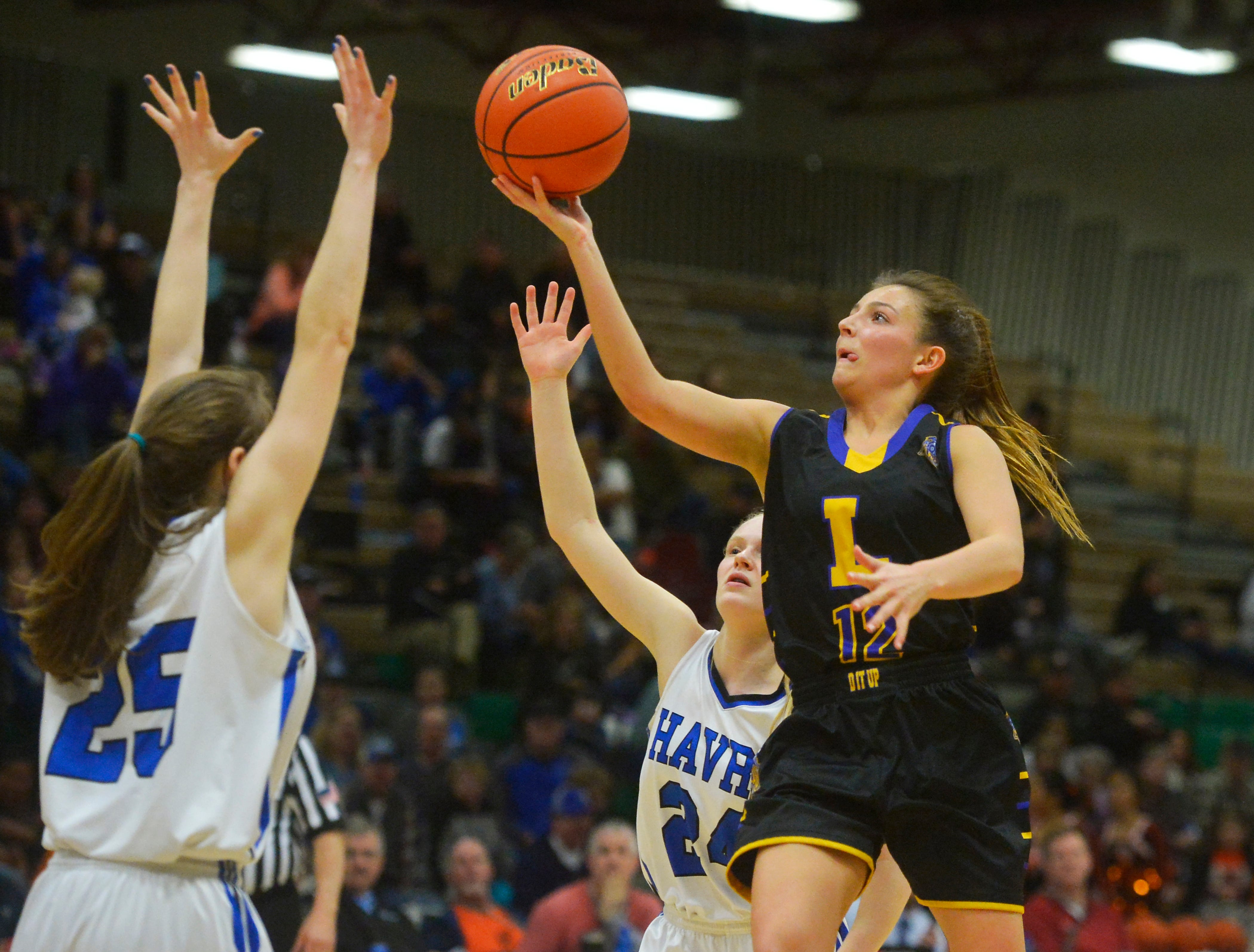 Laurel's Aspen Cotter shoots a layup in the semifinal game against Havre during the State Class A Basketball Tournament in the Four Seasons Arena, Friday.