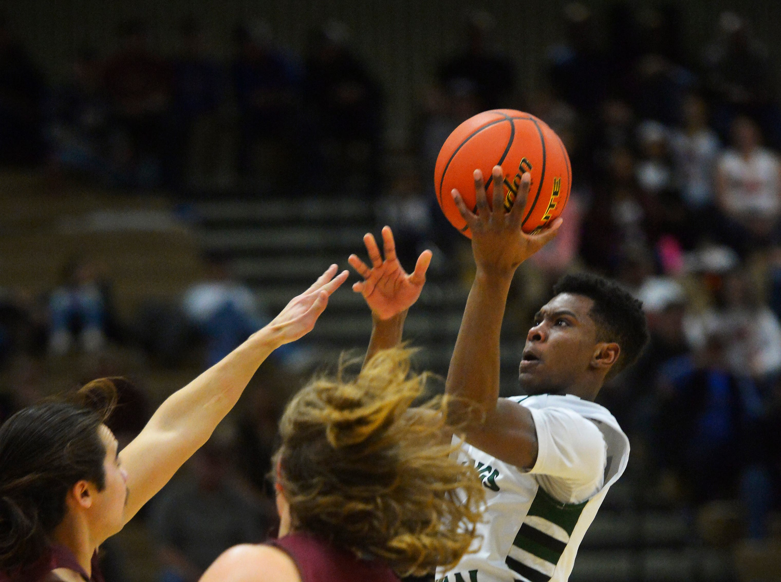 The Billings Central and Hamilton boys play in the semifinal game of the State Class A Basketball Tournament in the Four Seasons Arena, Friday.