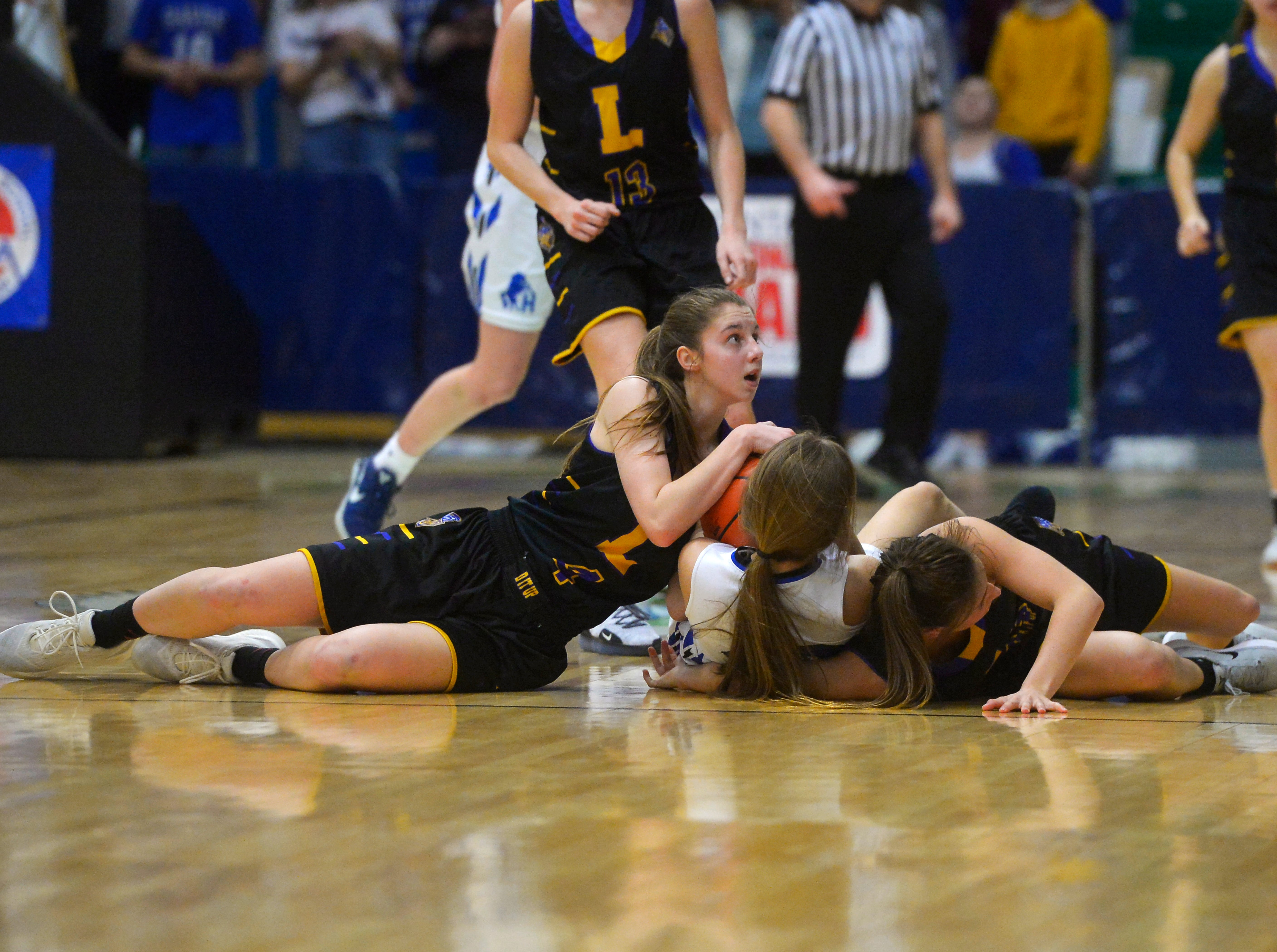 Havre and Laurel girls play in the semifinal round of the State Class A Basketball Tournament in the Four Seasons Arena, Friday.