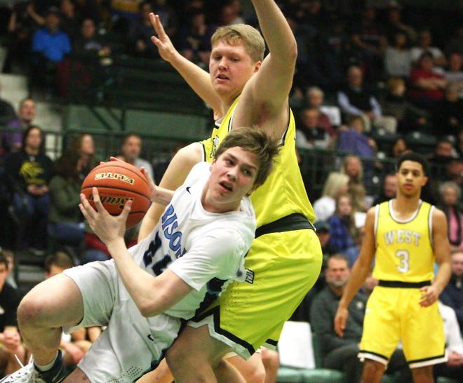 Great Falls' Drew Wyman looks to pass the ball while working against Billings West's Kobe Nelson during the State AA boys consolation final on Saturday at the Butte Civic Center.