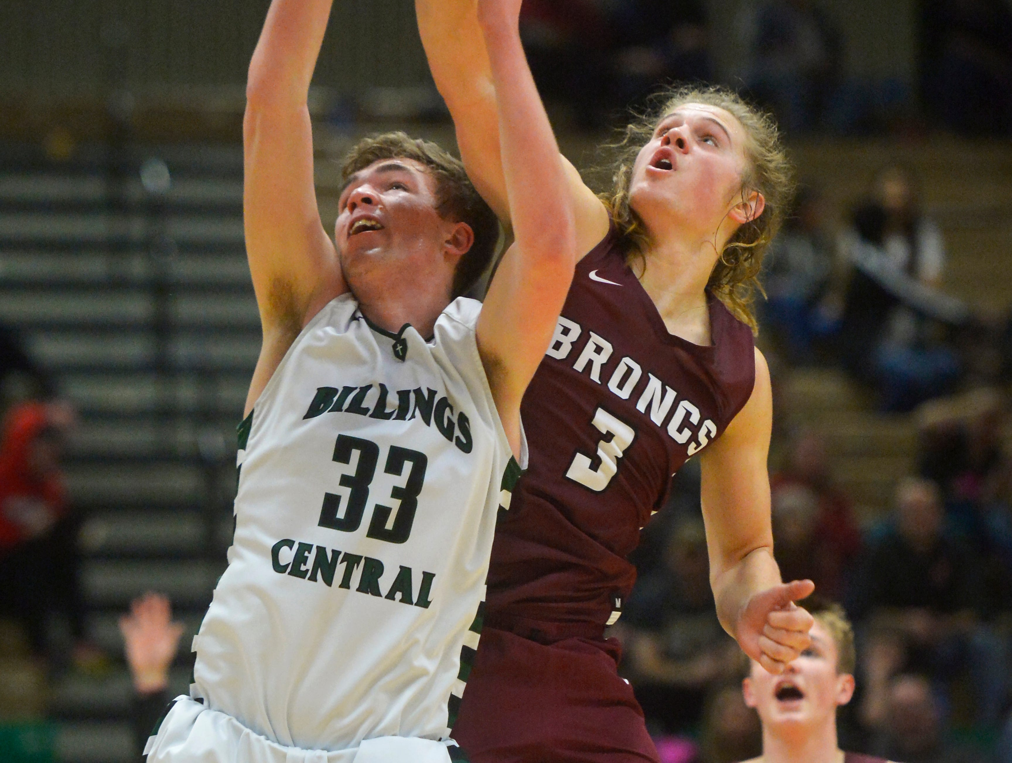 Hamilton's Carson Rostad blocks the shot of Billings Central's Sam Gray during the semifinal game of the State Class A Basketball Tournament in the Four Seasons Arena, Friday.