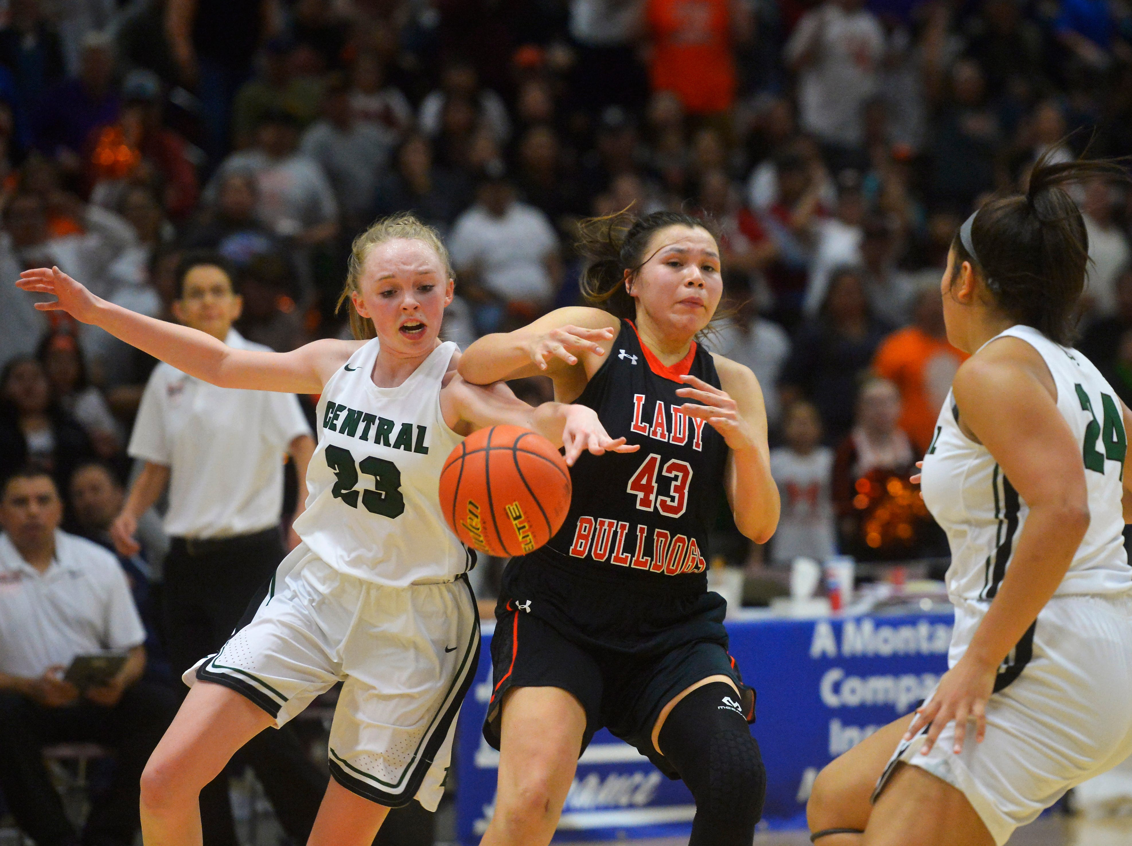 Billings Central's Isabelle Erickson knocks the ball away from Hardin's Marie Five in the girls semifinal game of the State Class A Basketball Tournament in the Four Seasons Arena, Friday.