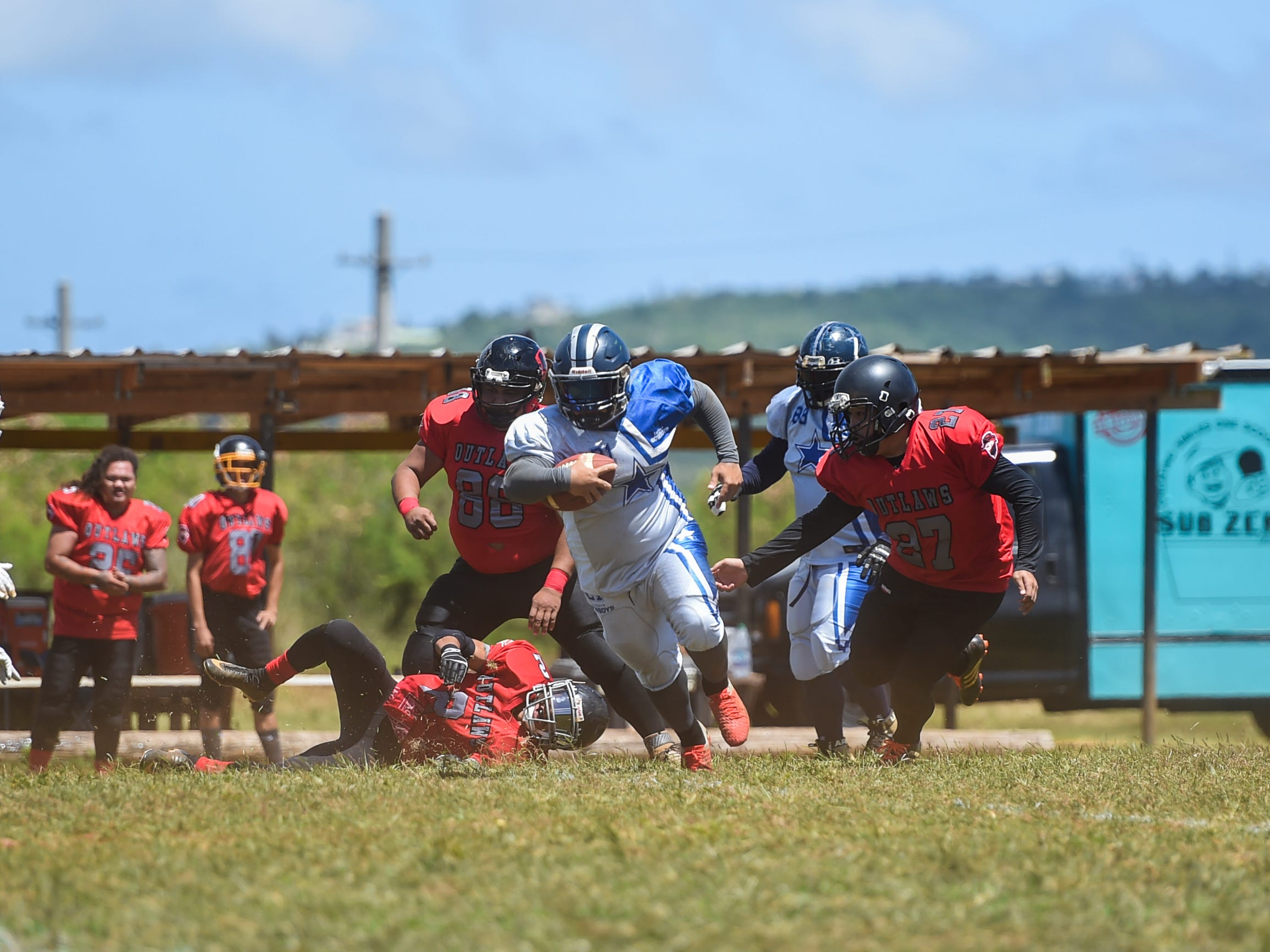 Southern Cowboys player Adam Lumba runs the ball against the Outlaws during a Budweiser Guahan Varsity Football League game at Eagles Field in Mangilao, March 9, 2019.