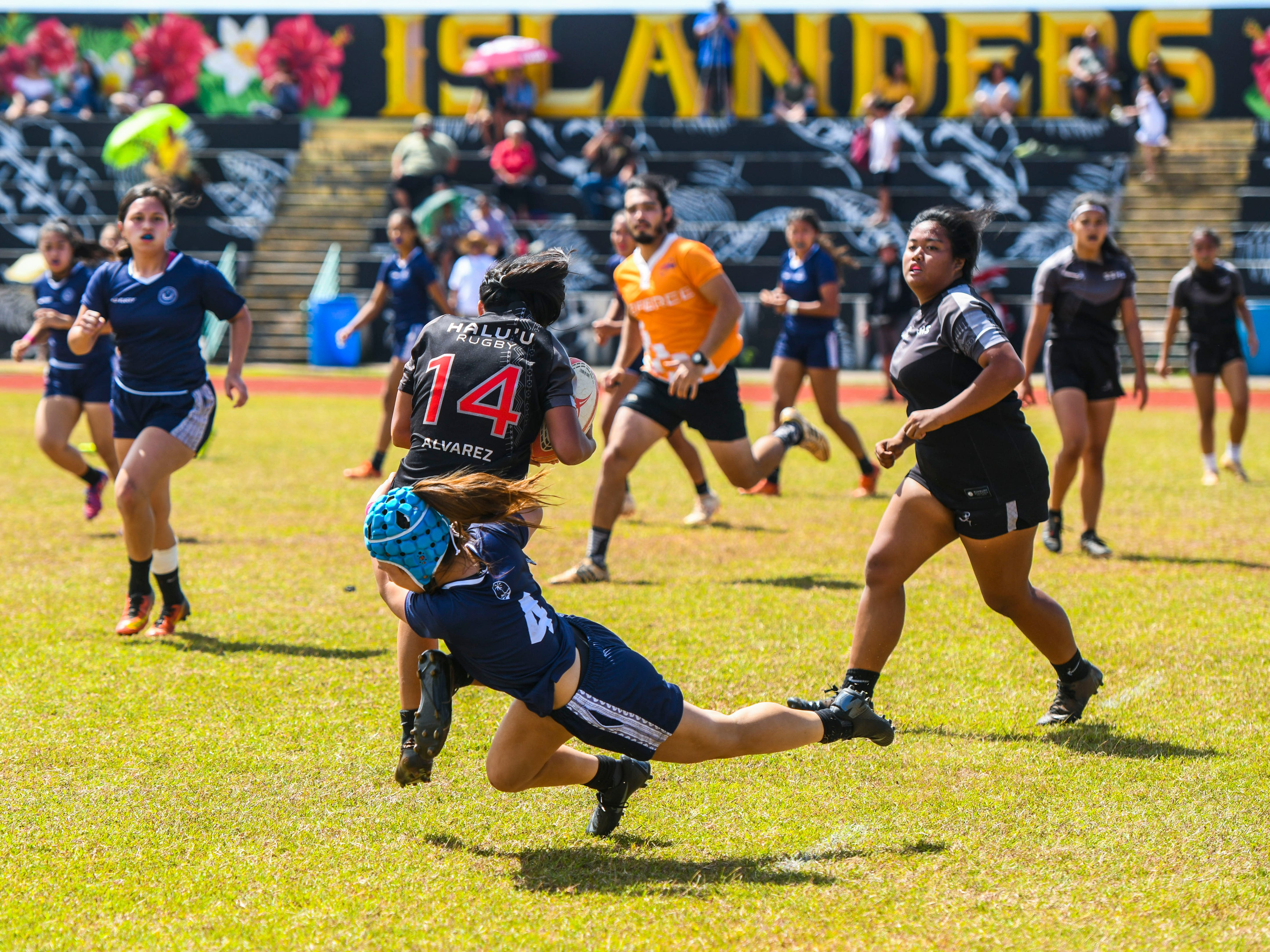 Notre Dame High School Royals' Faith Moylan tackles Simon Sanchez High School Sharks' ball-carrier during their Girls Varsity IIAAG/GRFU rugby matchup on Ramsey Field at the John F. Kennedy High School in Tamuning on Saturday, March 9, 2019. In the end, the Royals defeated the Sharks with a final score of 14-12.