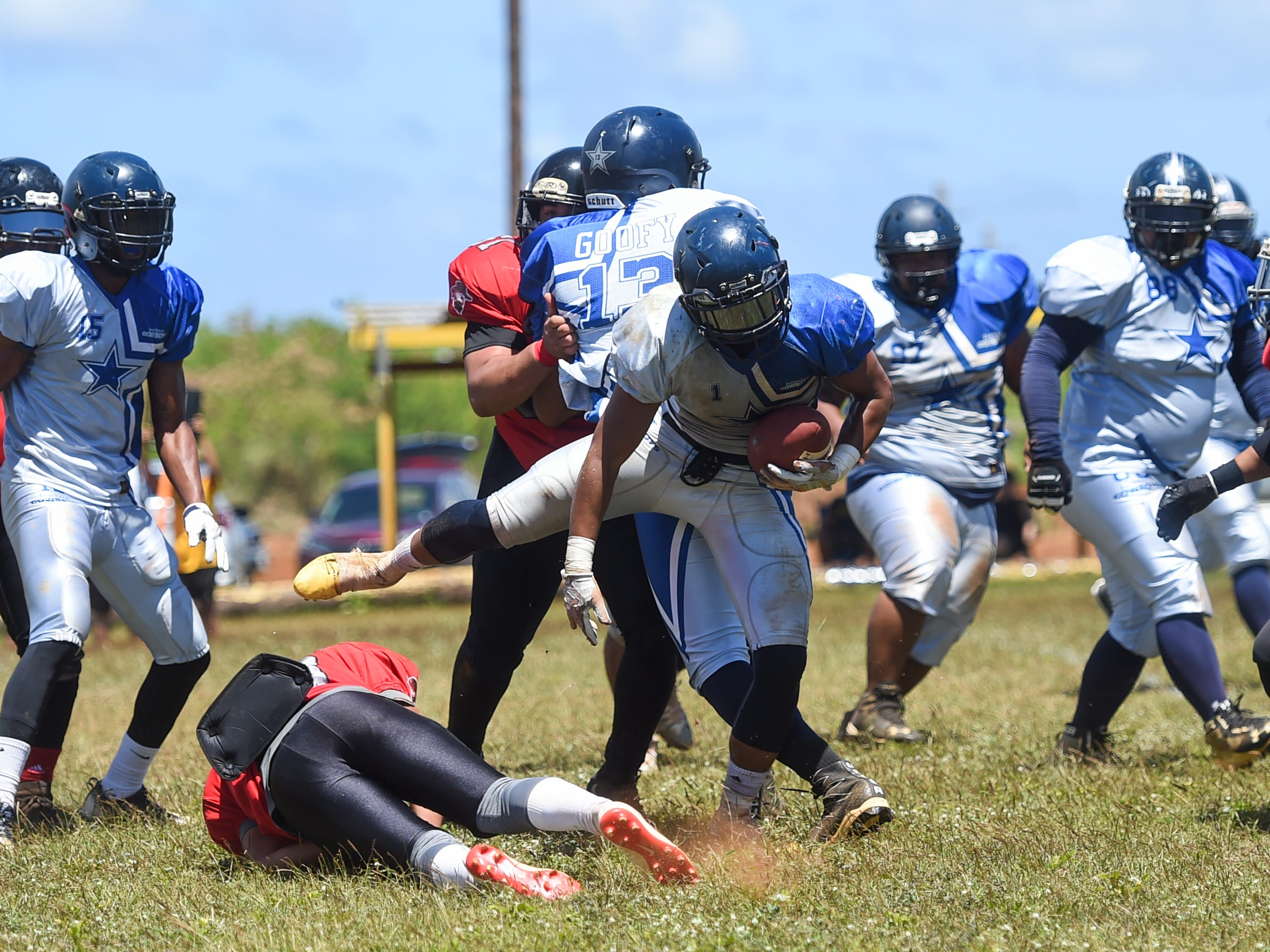 The Southern Cowboys' Connie Toney (1) avoids a tackle during a Budweiser Guahan Varsity Football League game against the Outlaws at Eagles Field in Mangilao, March 9, 2019.