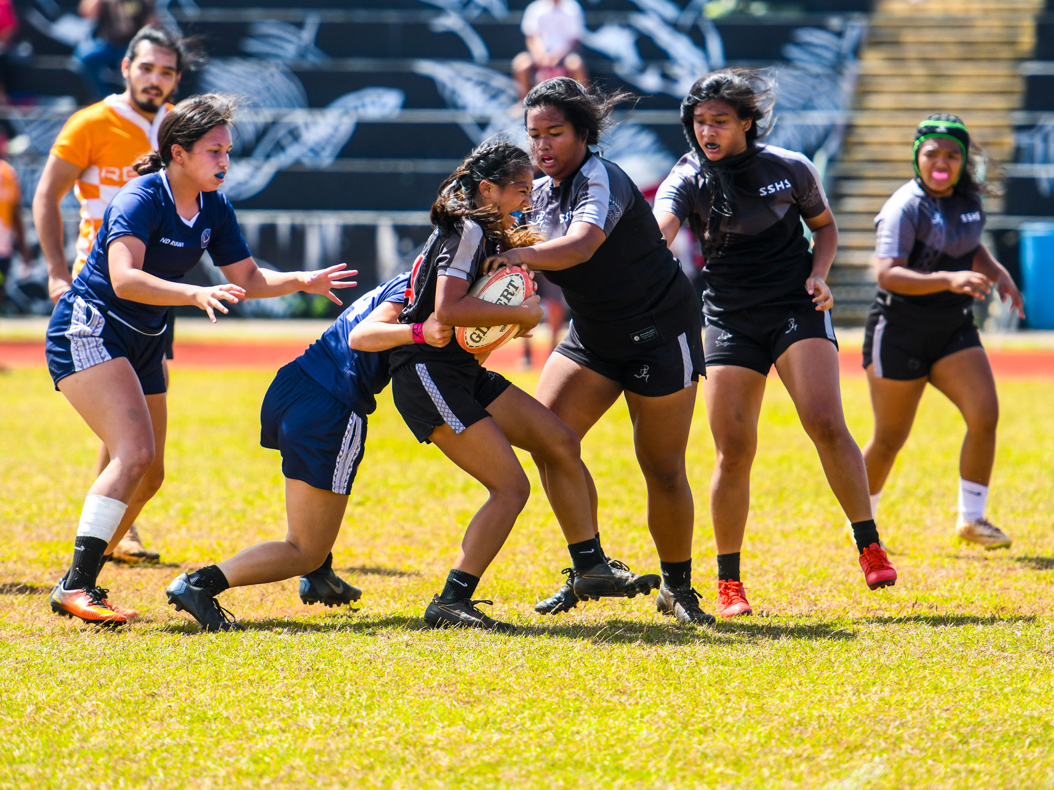 The Simon Sanchez High School Sharks competes against the Notre Dame High School Royals during their Girls Varsity IIAAG/GRFU rugby matchup on Ramsey Field at the John F. Kennedy High School in Tamuning on Saturday, March 9, 2019. In the end, the Royals defeated the Sharks with a final score of 14-12.