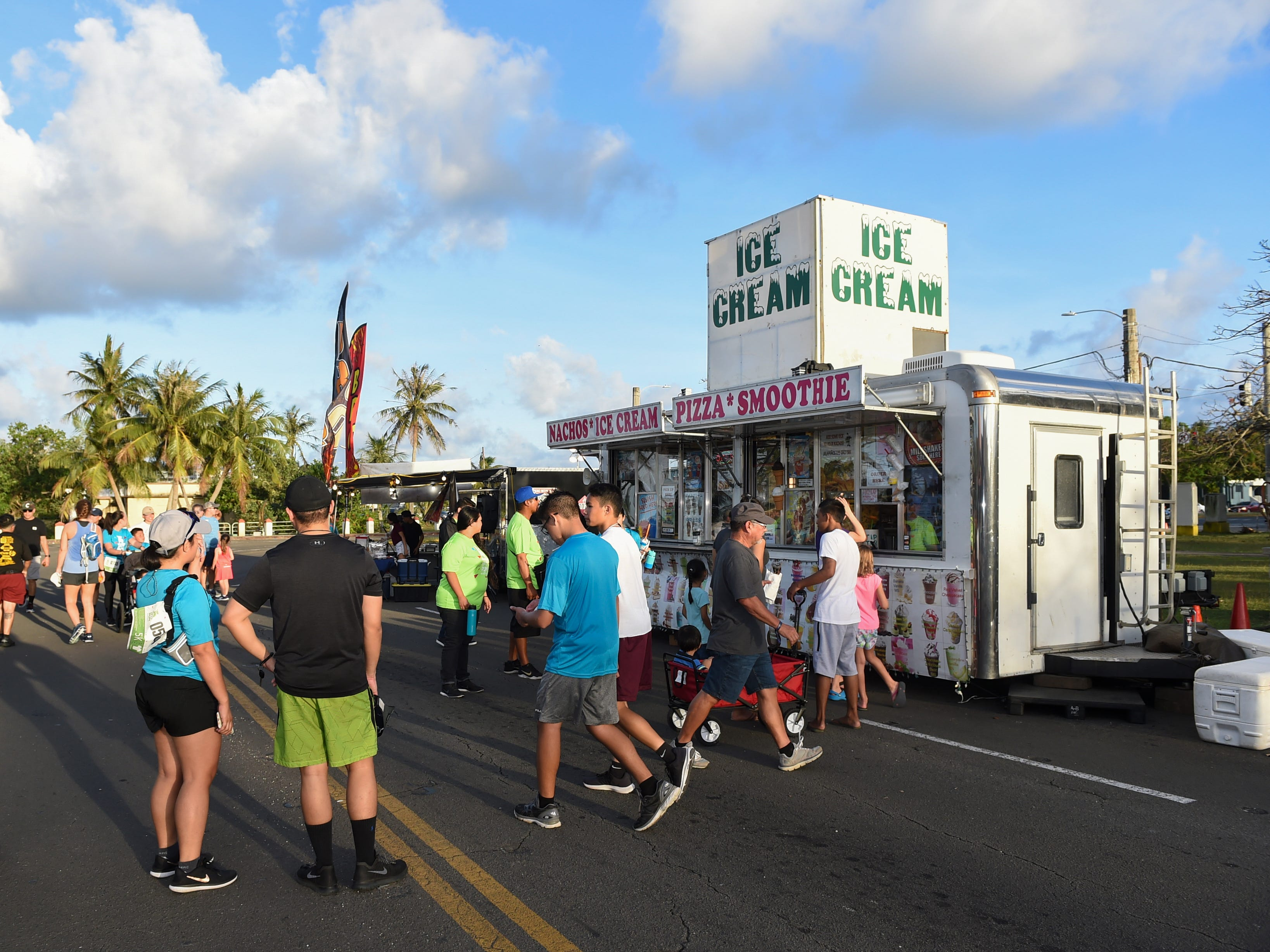 Event attendees get their food truck fixes during the Bank of Guam Ifit Run and Block Party at Chamorro Village in Hagåtña, March 9, 2019.