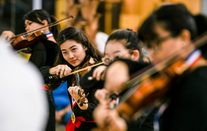 Members of the string ensemble, Stringstars, perform for those in attendance at the Tumon Bay Music Festival Encore Finale Concert and Award Ceremony in the center court of Micronesia Mall in this March 9, 2019, file photo.