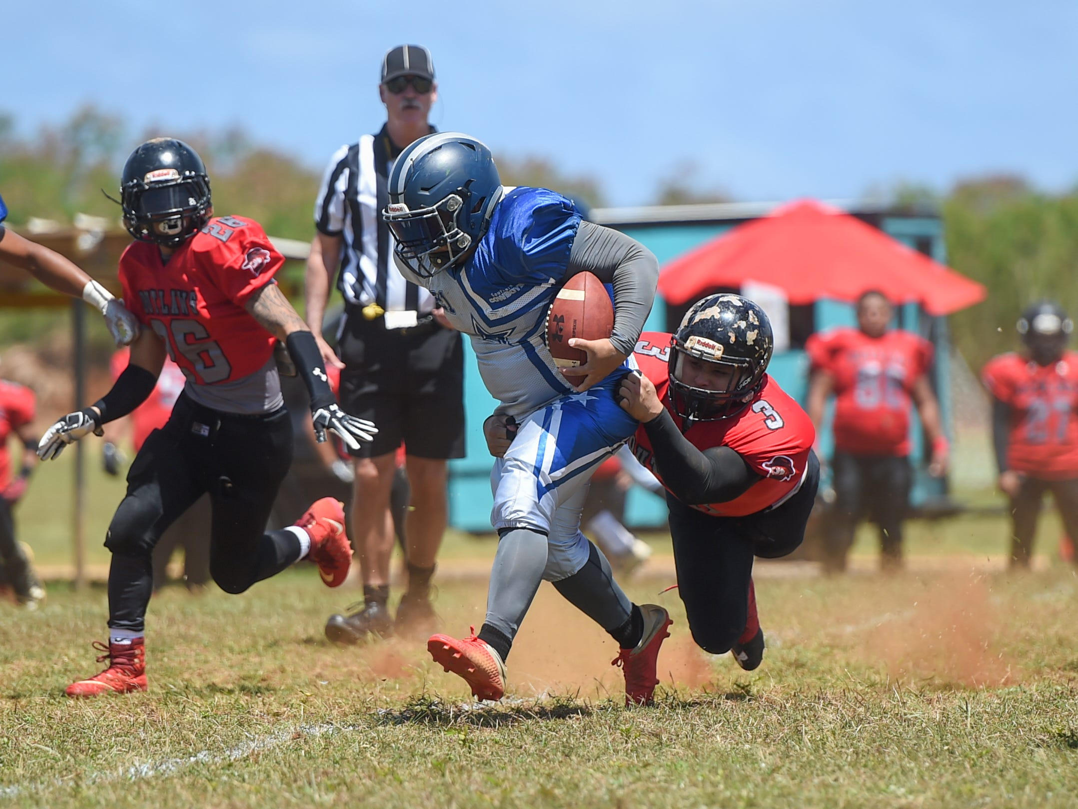 Outlaws player Frankie Fernandez (3) attempts a tackle during a Budweiser Guahan Varsity Football League game against the Southern Cowboys at Eagles Field in Mangilao, March 9, 2019.