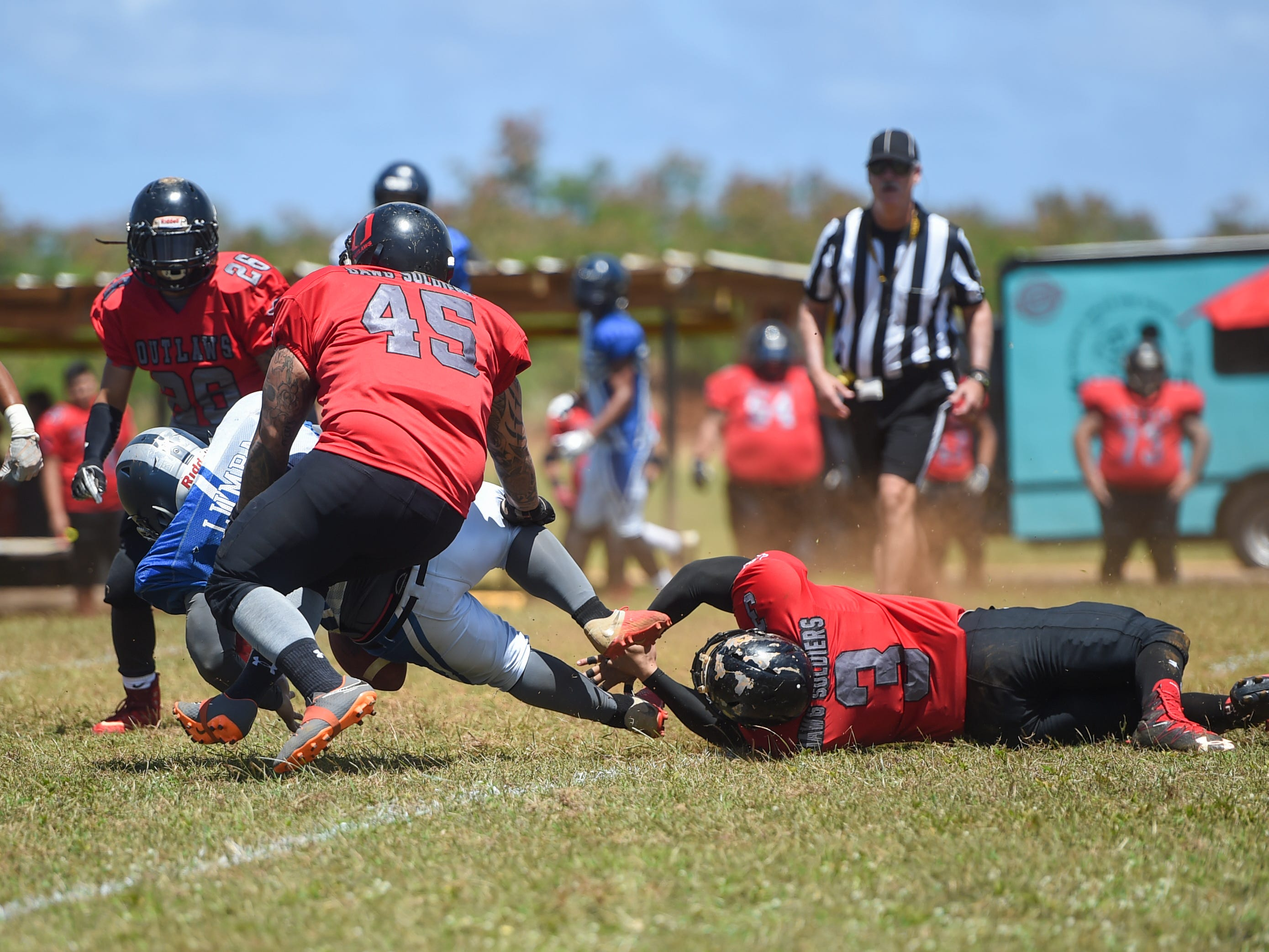 Outlaws player Frankie Fernandez (3) gets a tackle on Southern Cowboys' Adam Lumba during a Budweiser Guahan Varsity Football League game at Eagles Field in Mangilao, March 9, 2019.